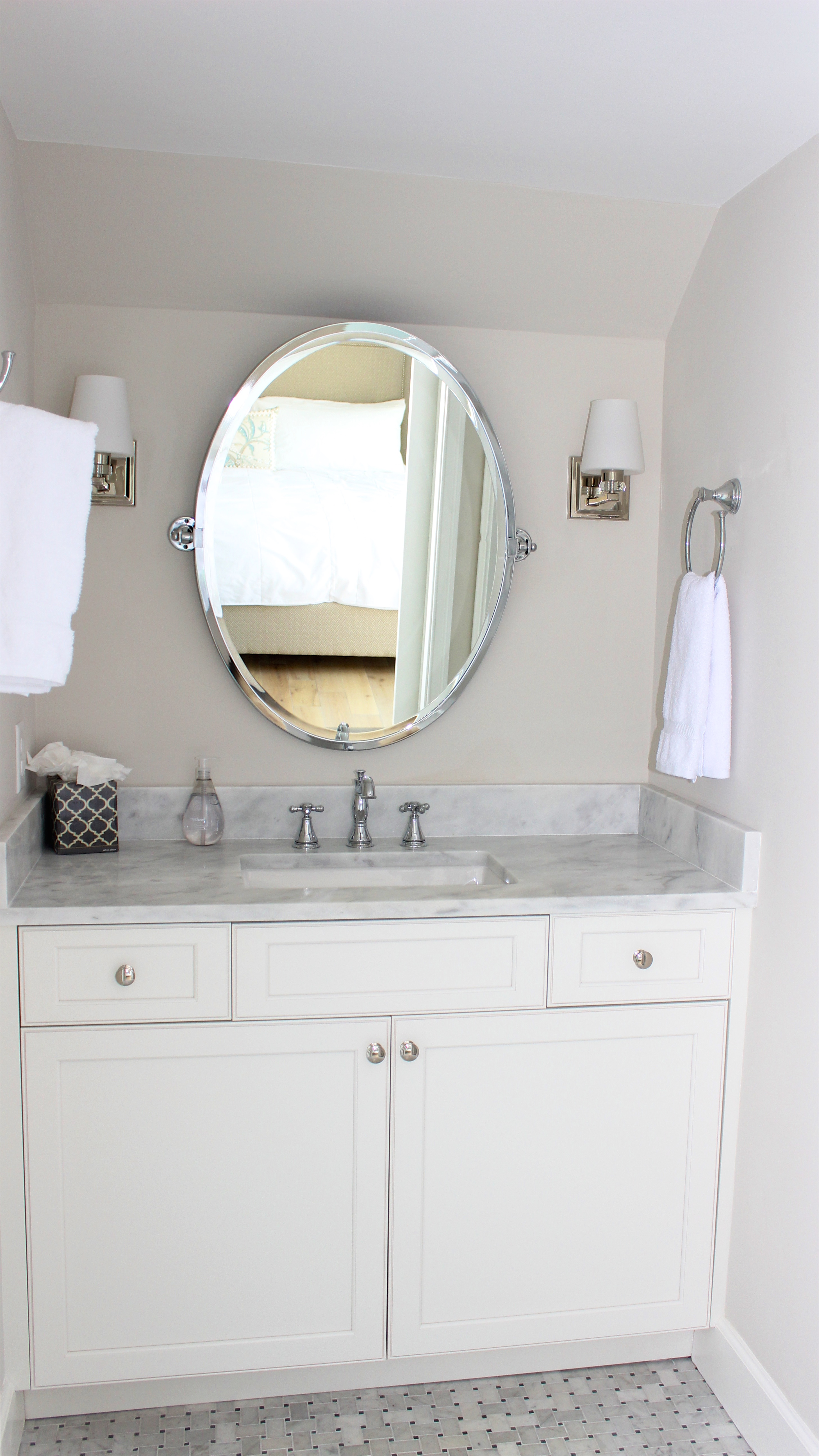 Great tile and a granite topped vanity are highlights.