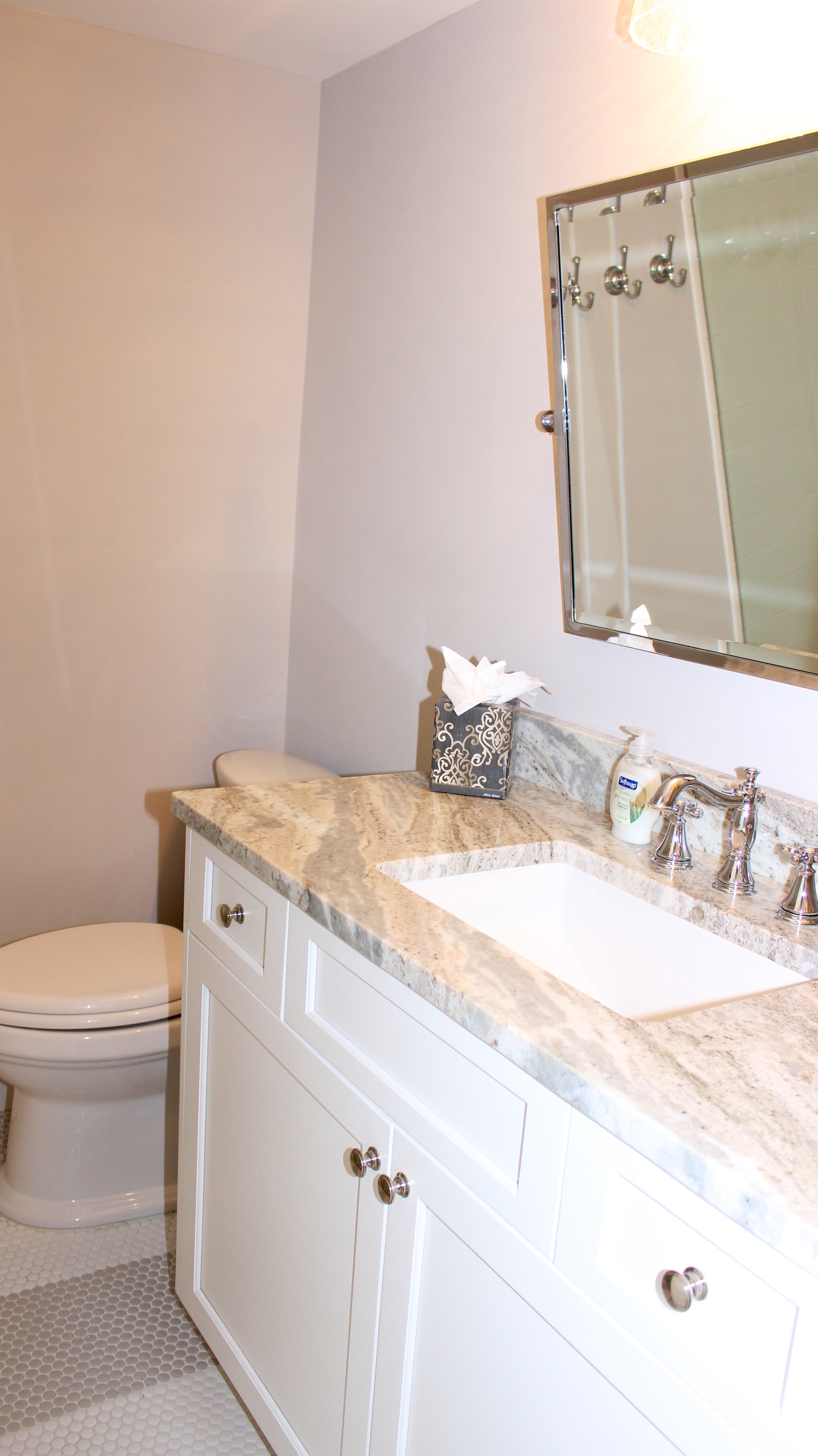 The hall bath has been beautifully updated. Features include a granite counter and tile floor.