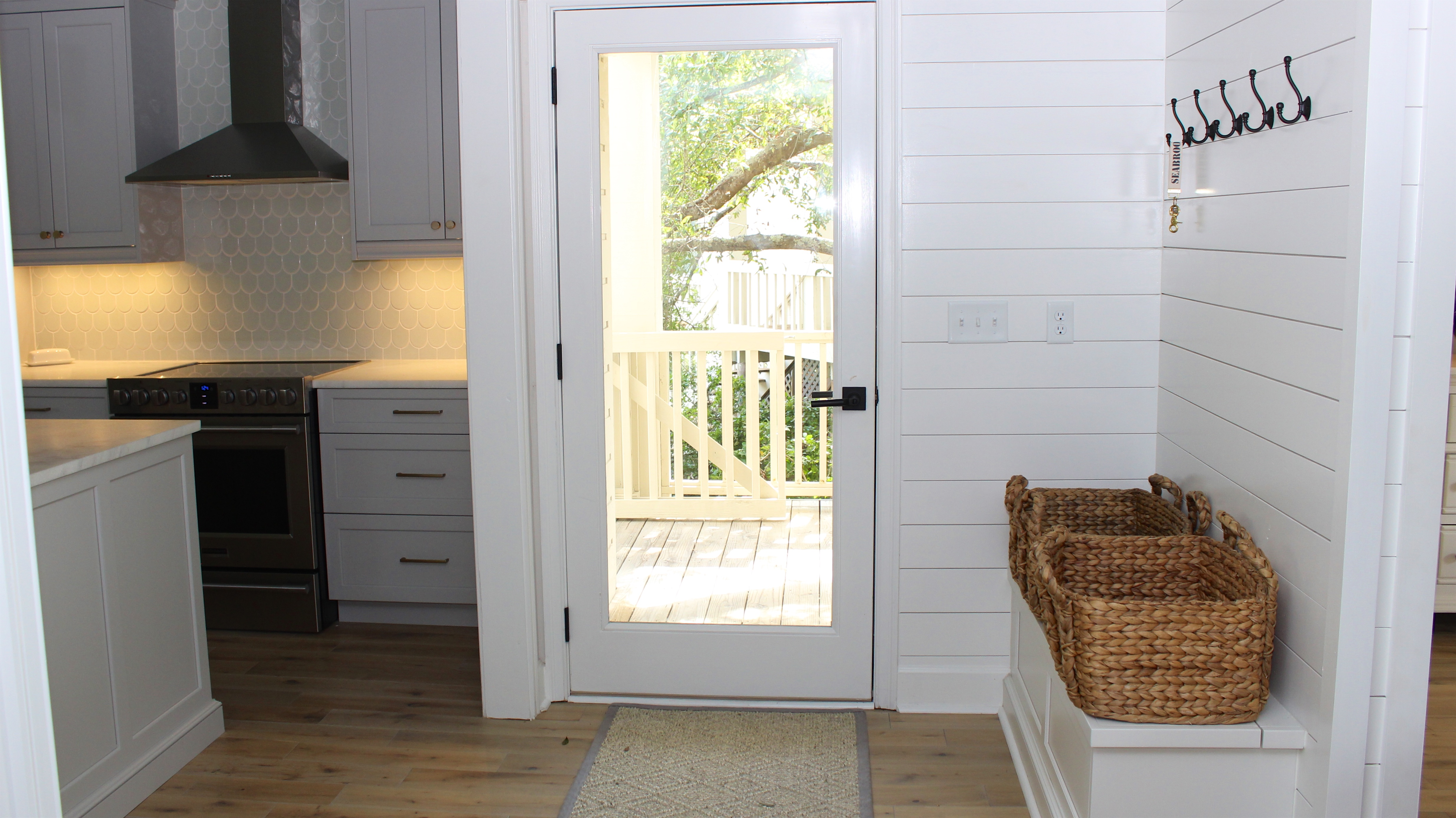 Shiplap paneling and a bench create a welcoming entry.