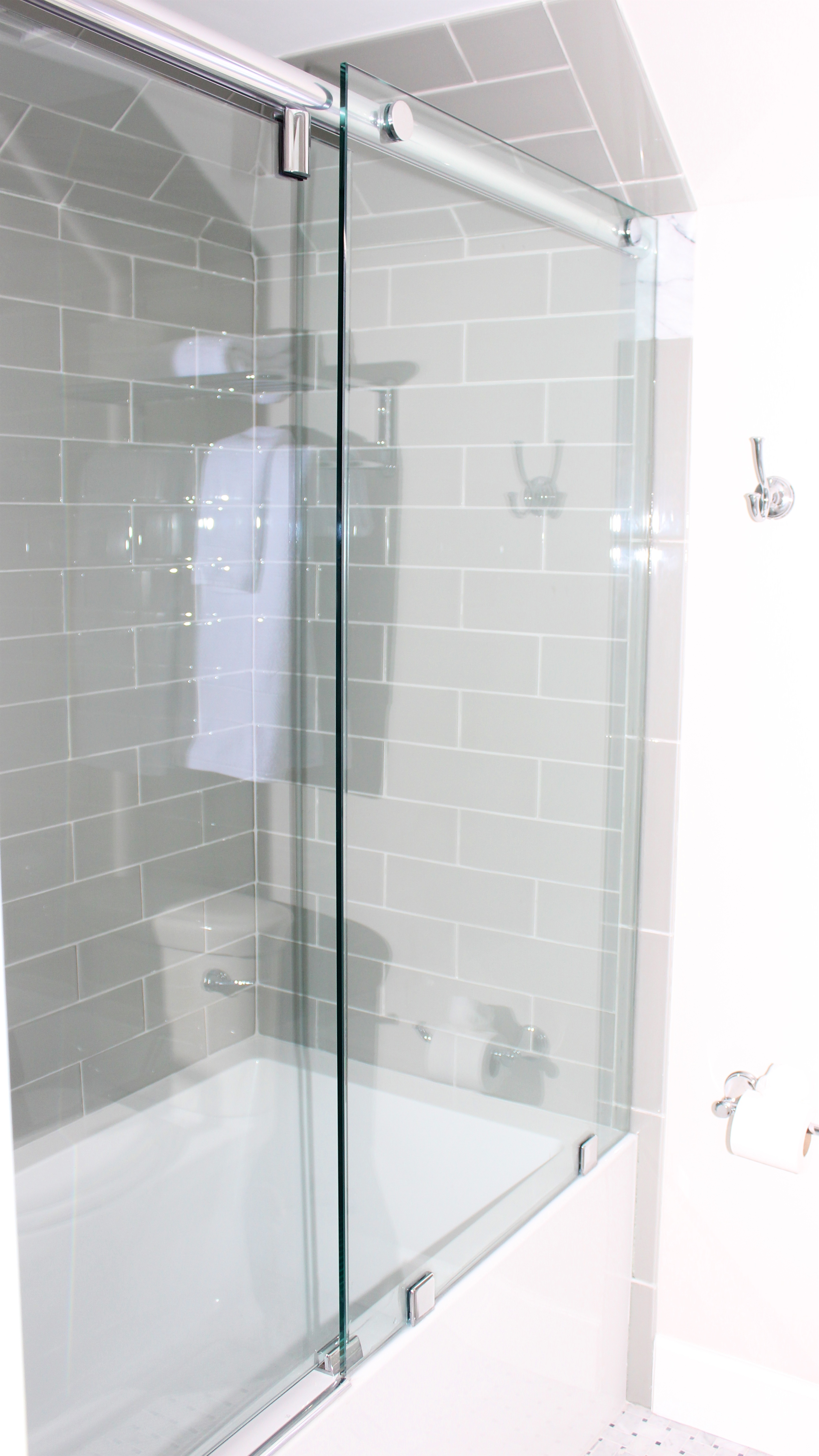 There is a sky light (not seen) and a tiled tub/shower.