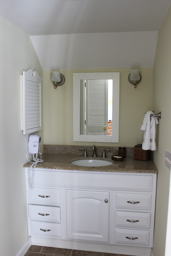 The bath has a separate sink area, hairdryer, and large closet.