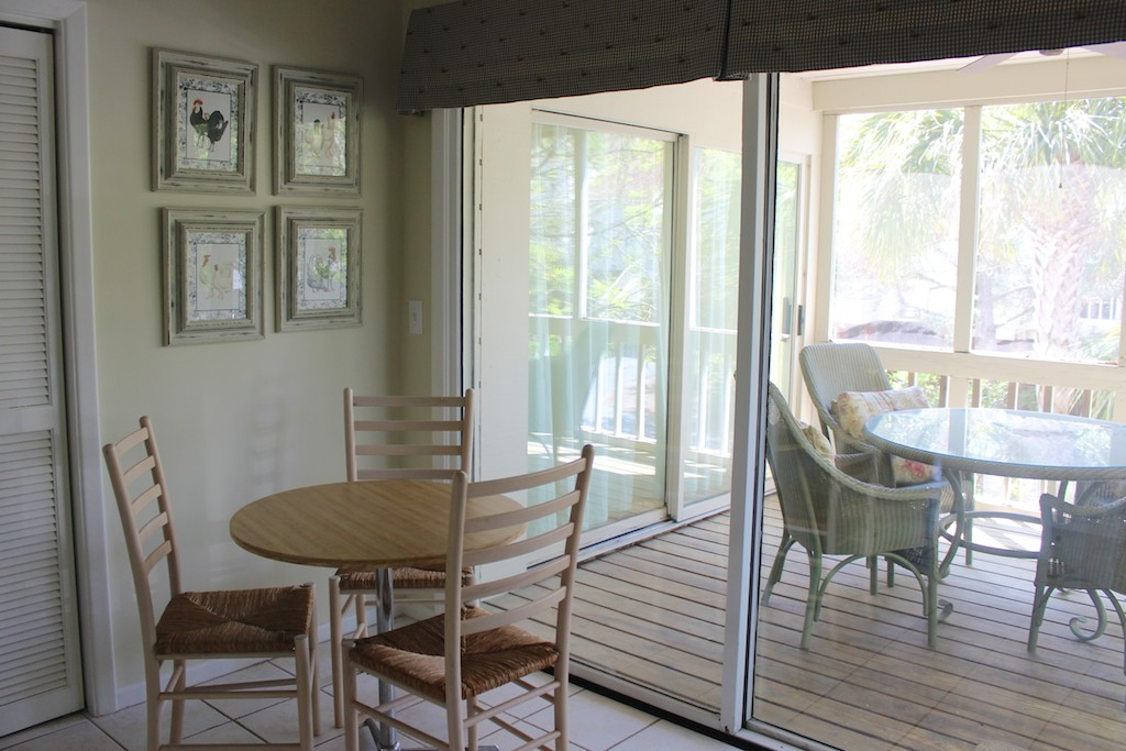 Eat around the kitchen table or at the table on the screened porch.