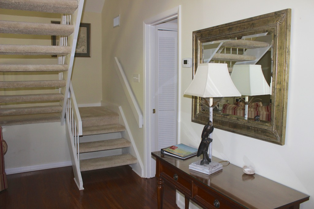 Head upstairs to the master bedroom.