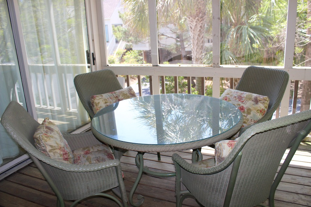 Share stories from your day around the table on the screened porch.