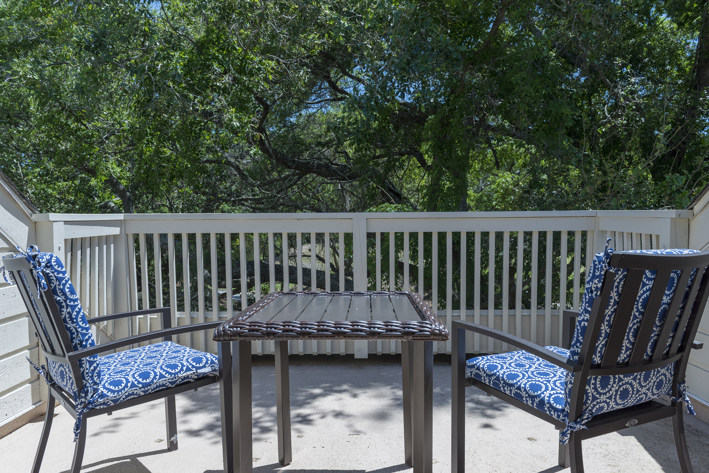 Deck 2 provides a shady spot to enjoy your morning coffee and catch sight of the golfers on Crooked Oak.