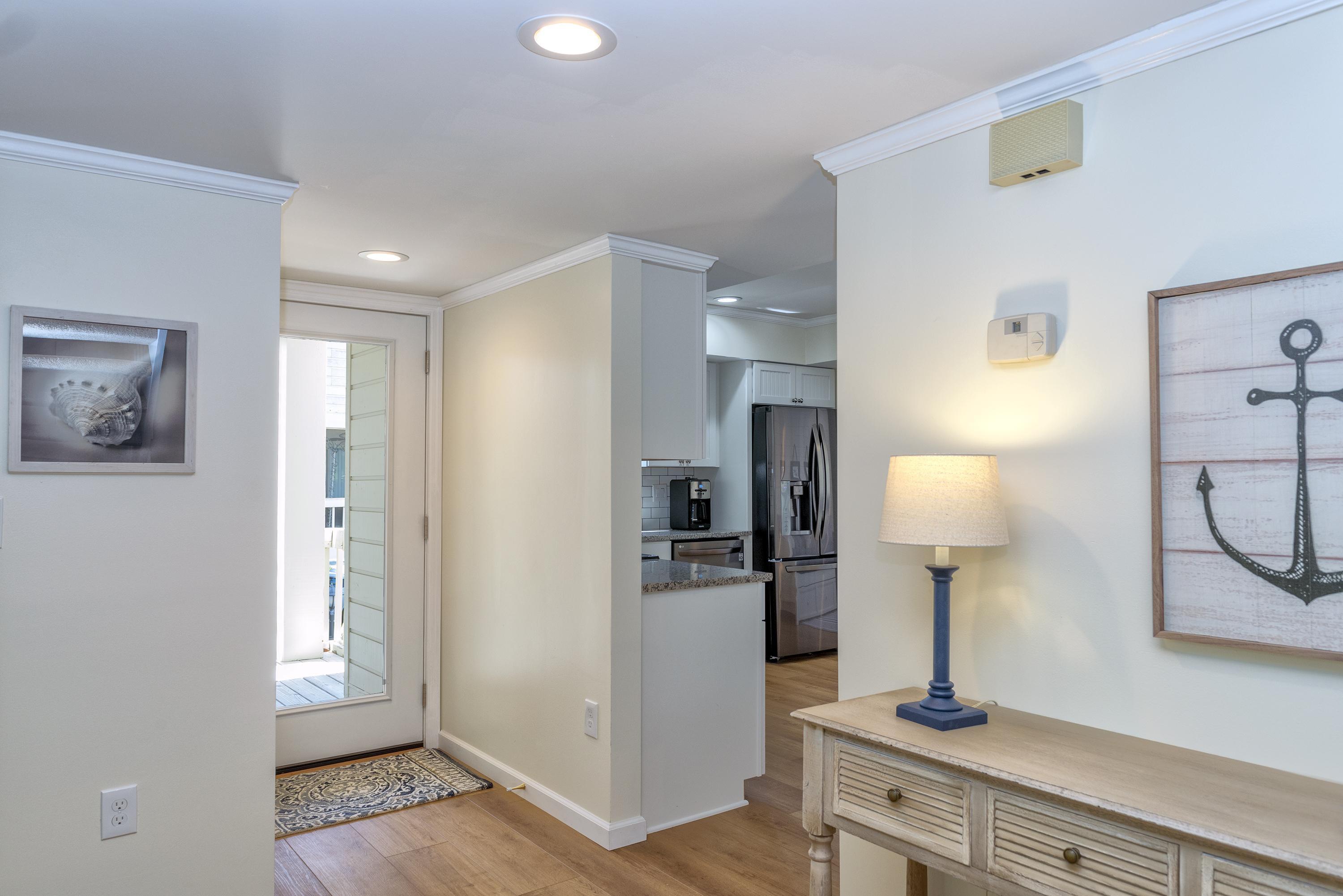 You enter through the front door into a light filled, beautifully decorated beach home.