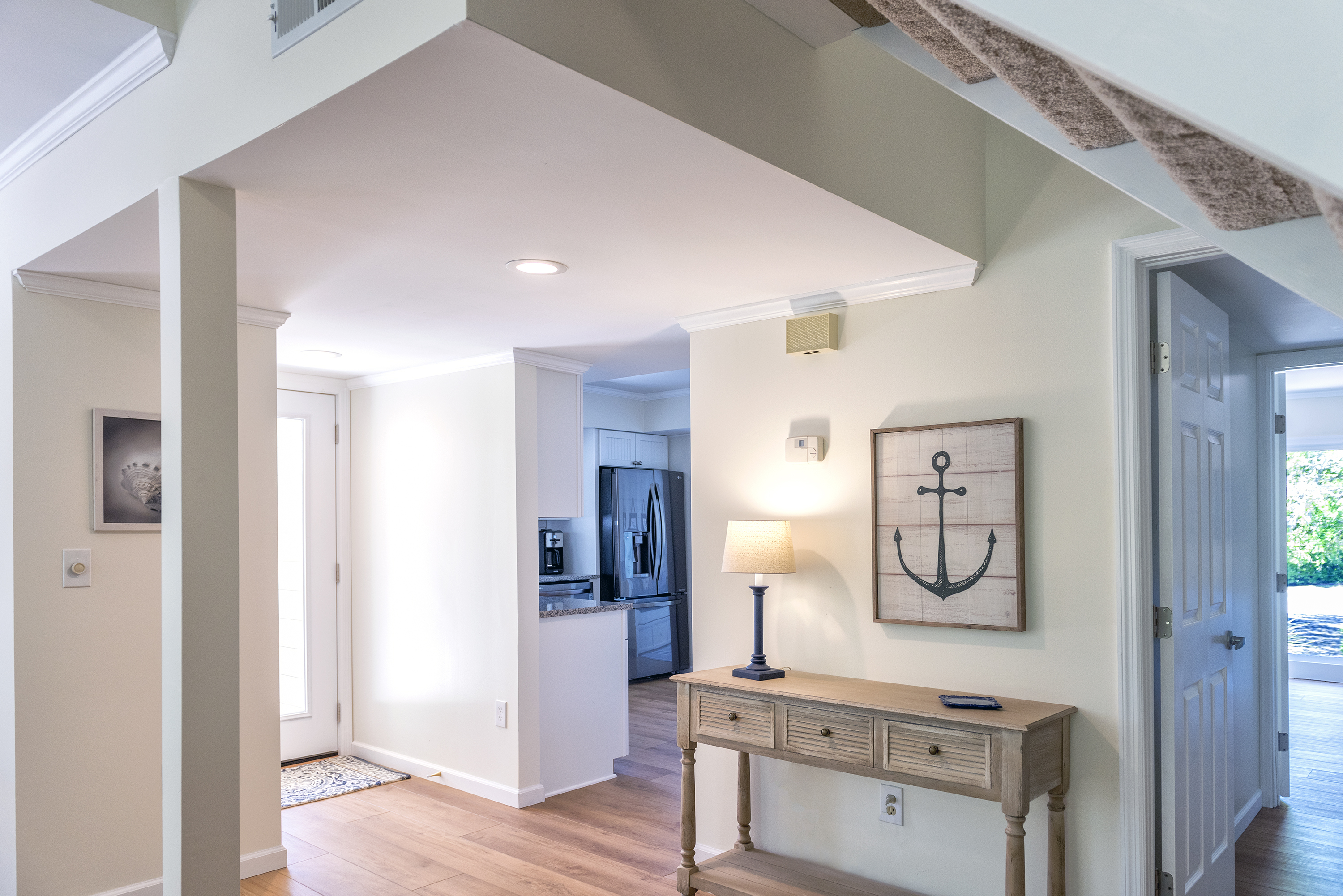 Hardwood floors and a neutral paint tone fill this beach home.