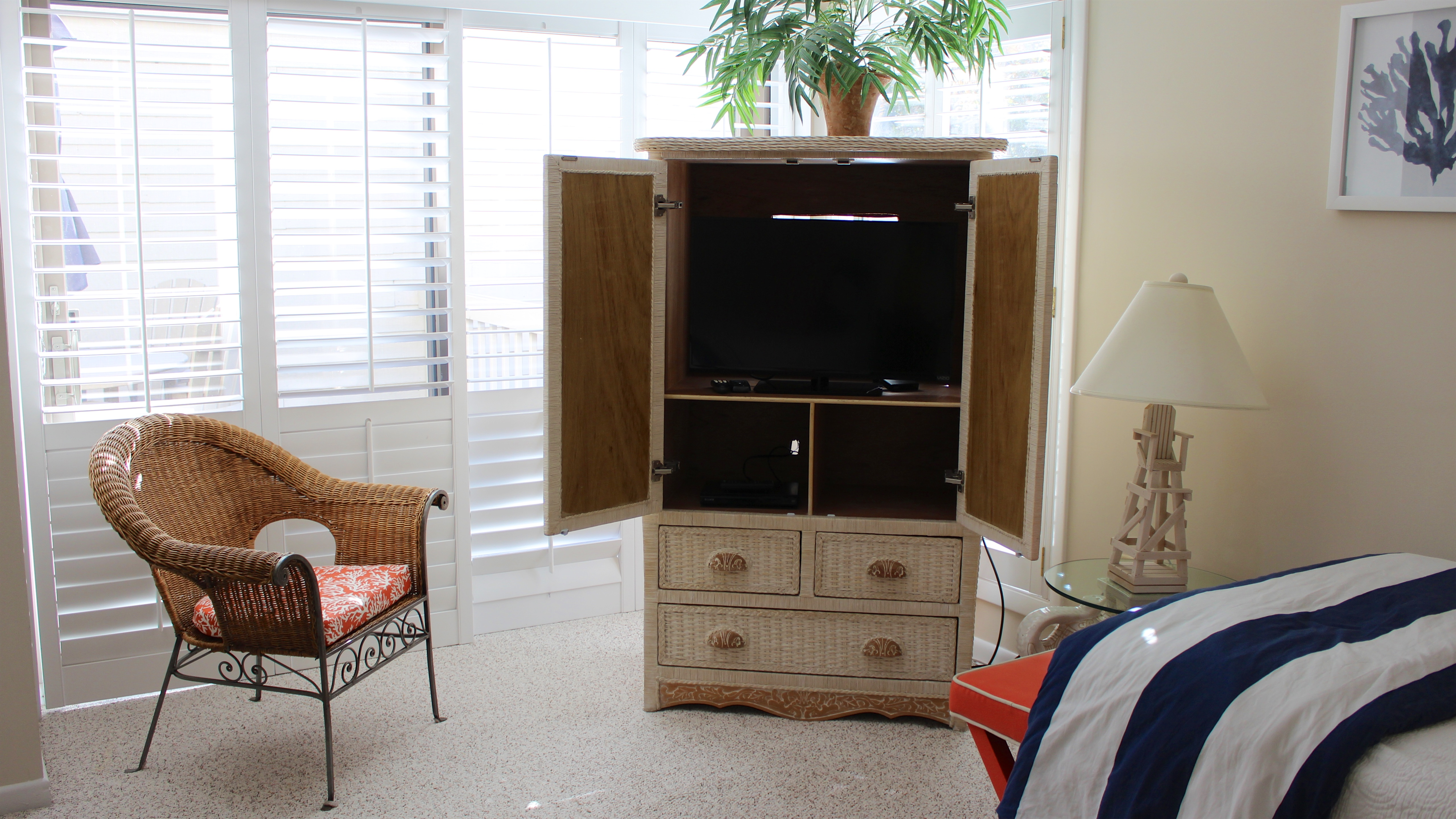 The armoire not only provides some storage for clothing, but also has an HDTV.