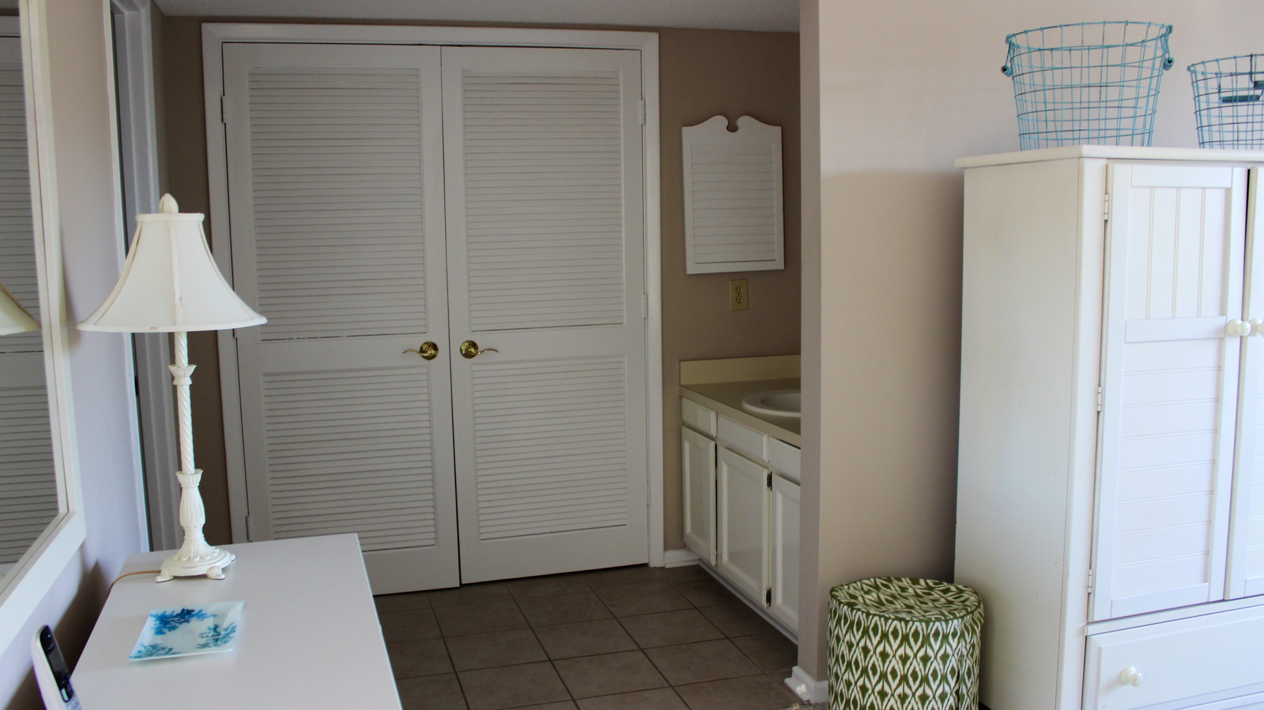 The master bath has a separate sink area and large closet.