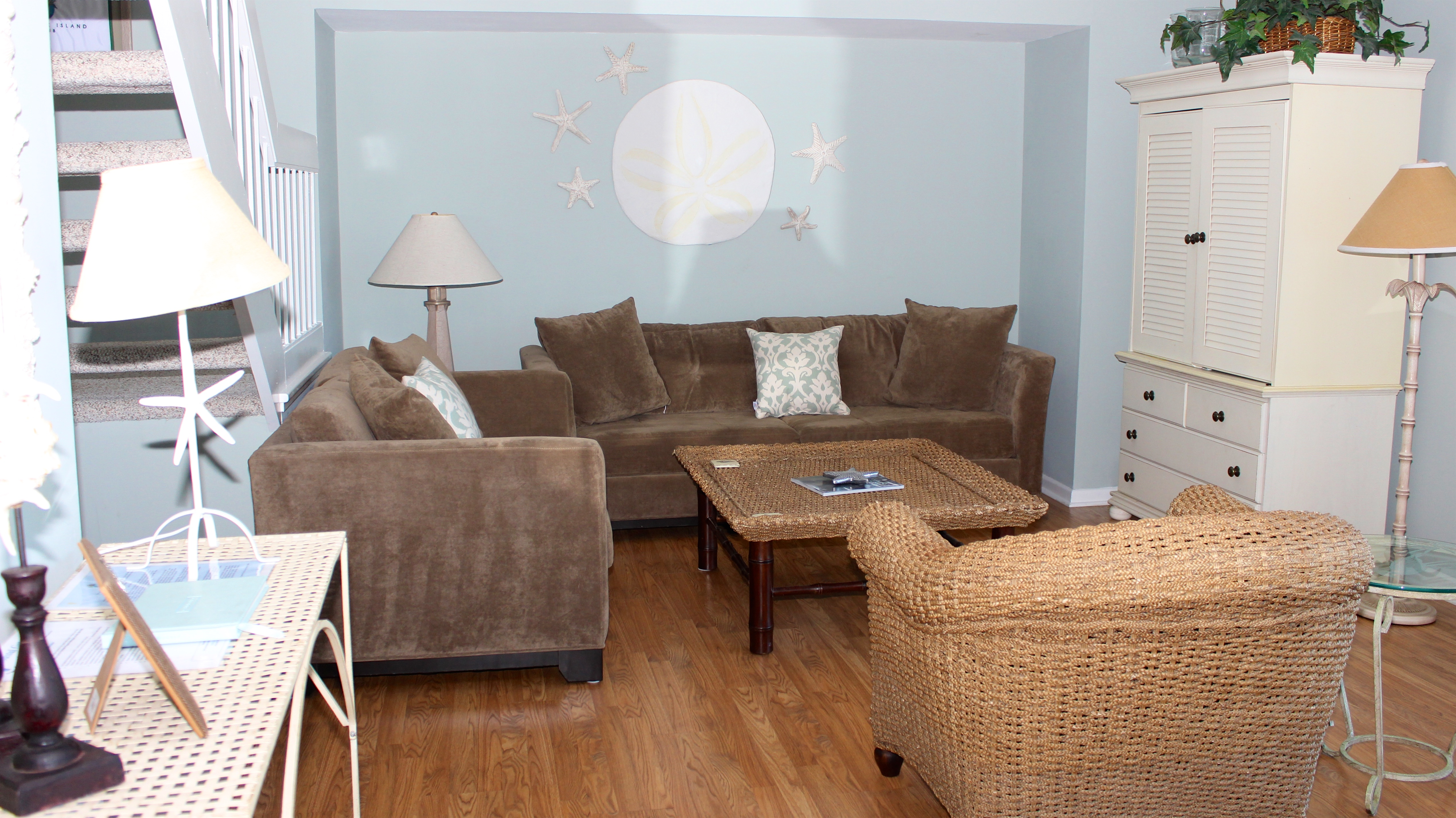 Soft blues/tans and hardwood floors greet you when you enter this roomy home.