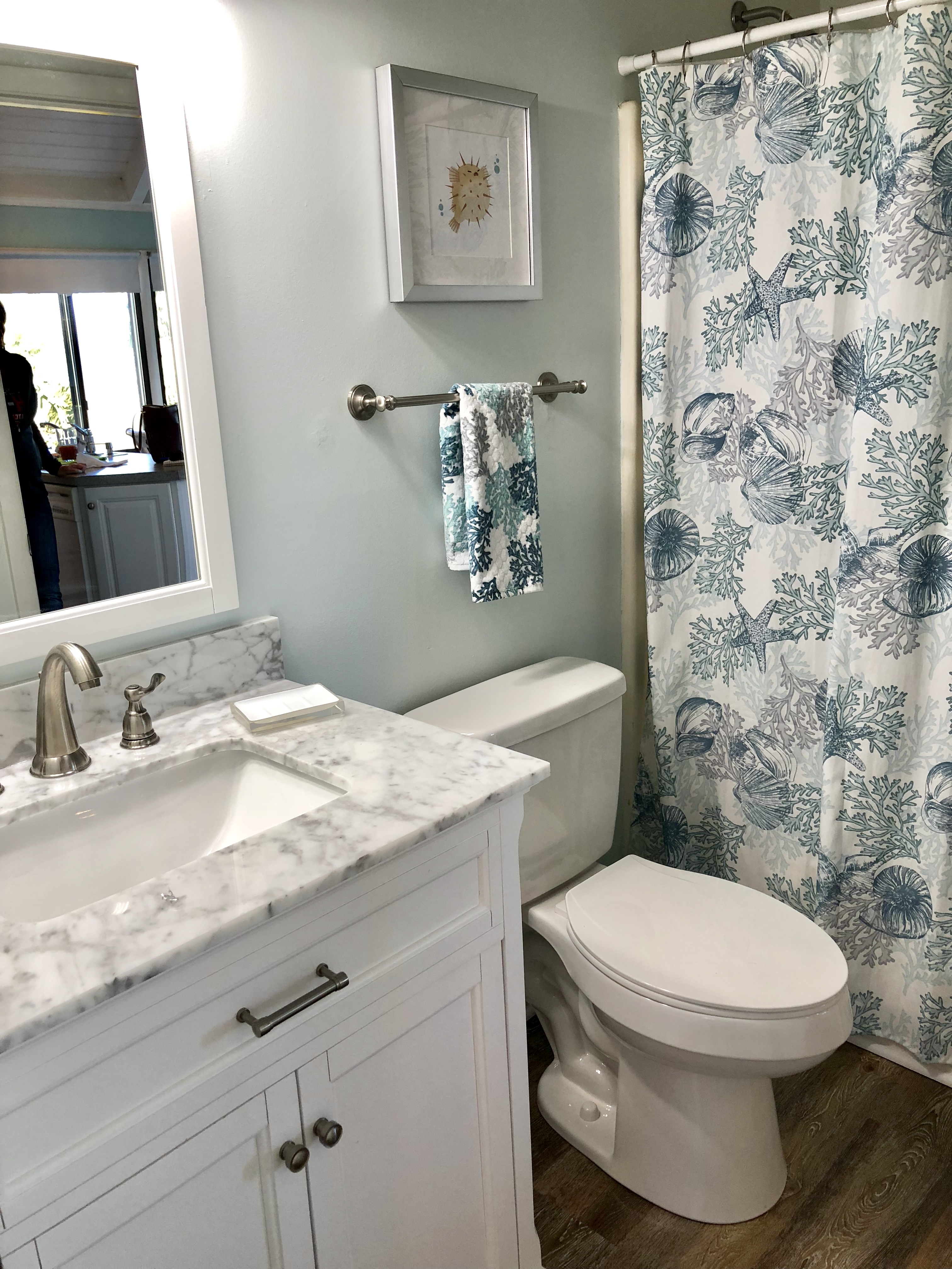 The hall bathroom has a marble top vanity and a tub/shower combination.