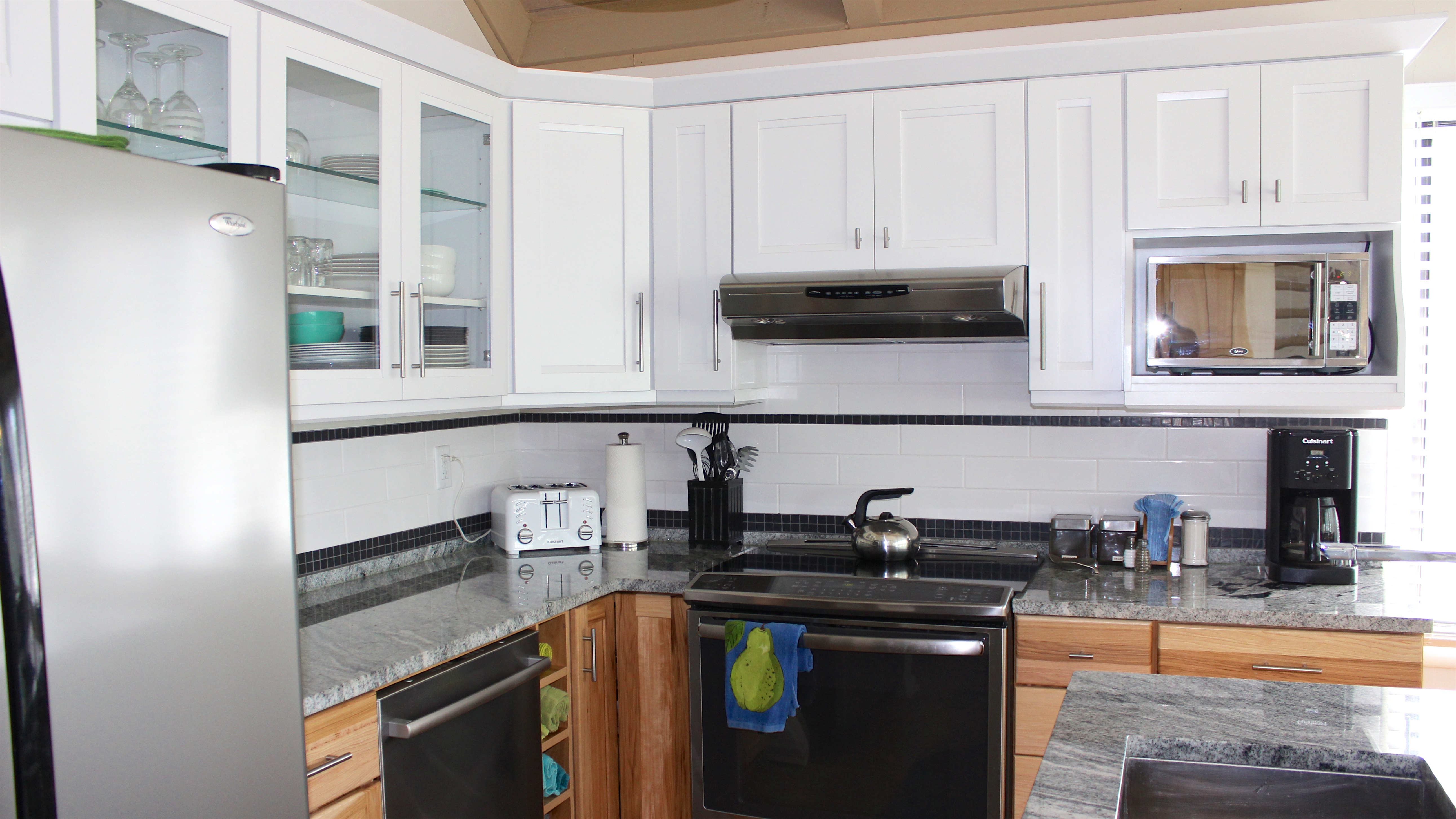 It has a drop-in stove, top of the line dishwasher, & glass accent cabinets.
