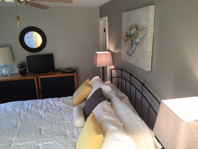 First floor master bedroom has neutral tones and a king sized bed.