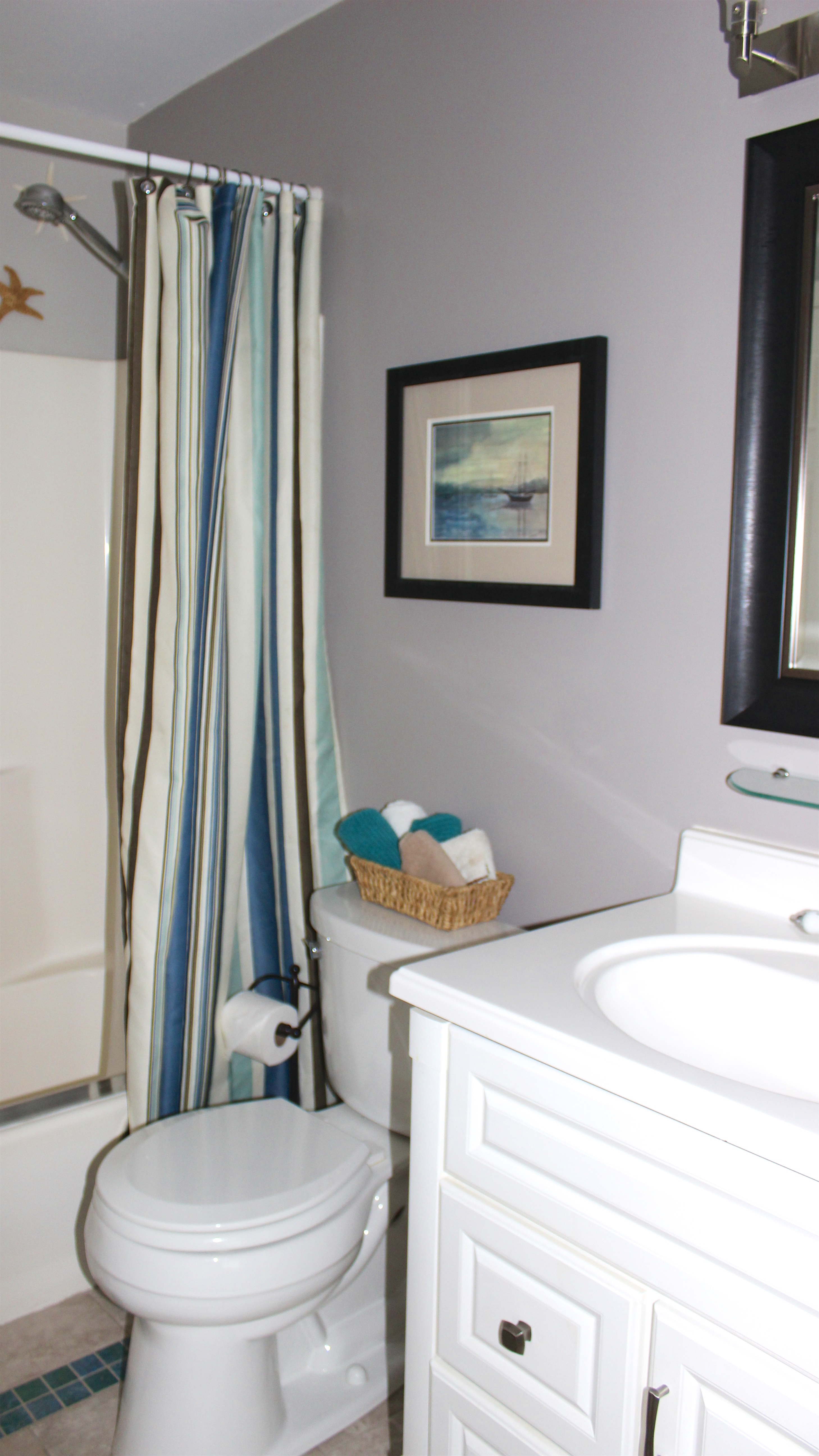 Recently redecorated, the bathroom is accessible from both the hall and bedroom.