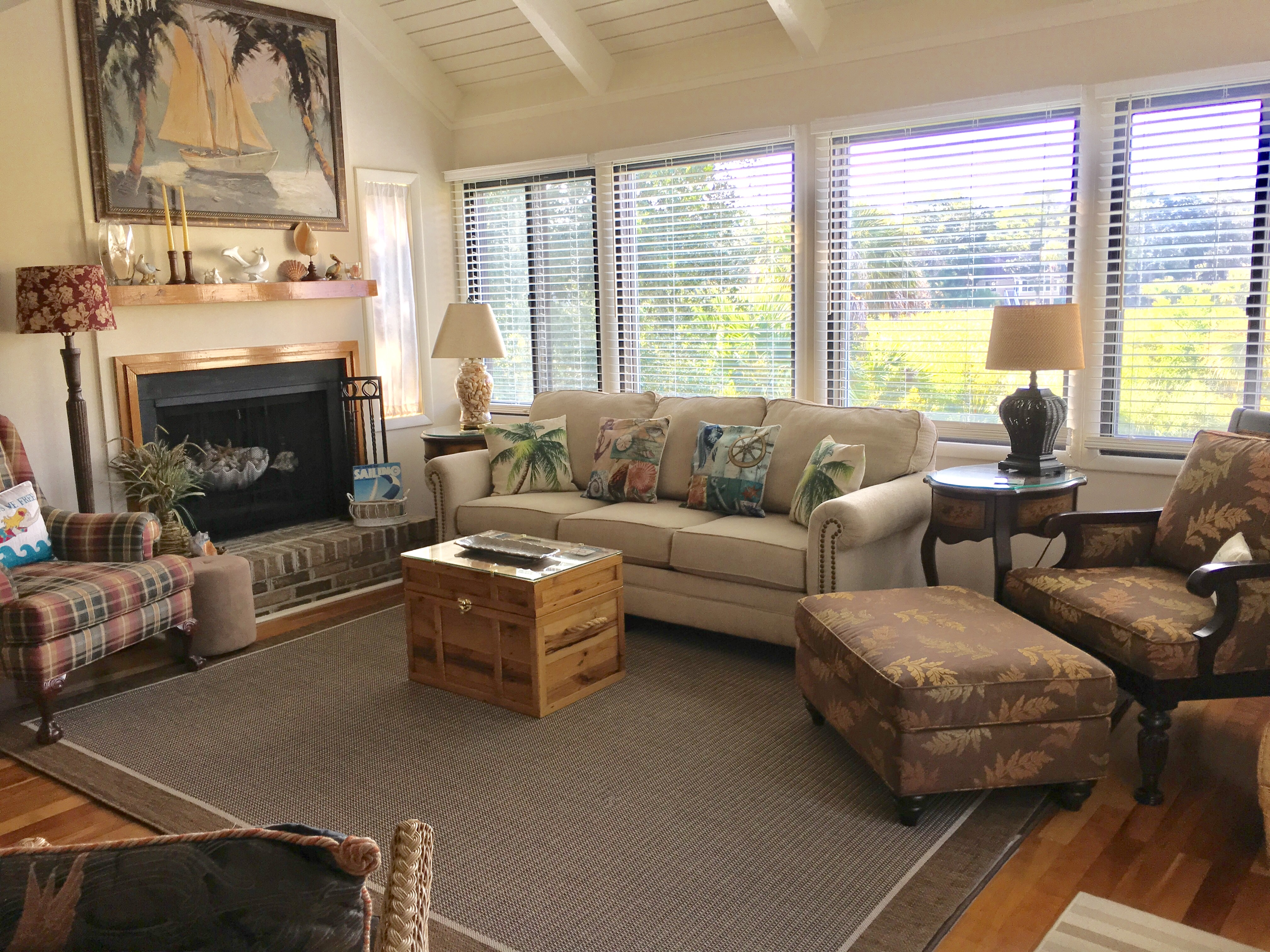 Comfortable living room furniture to relax after a day at the beach.