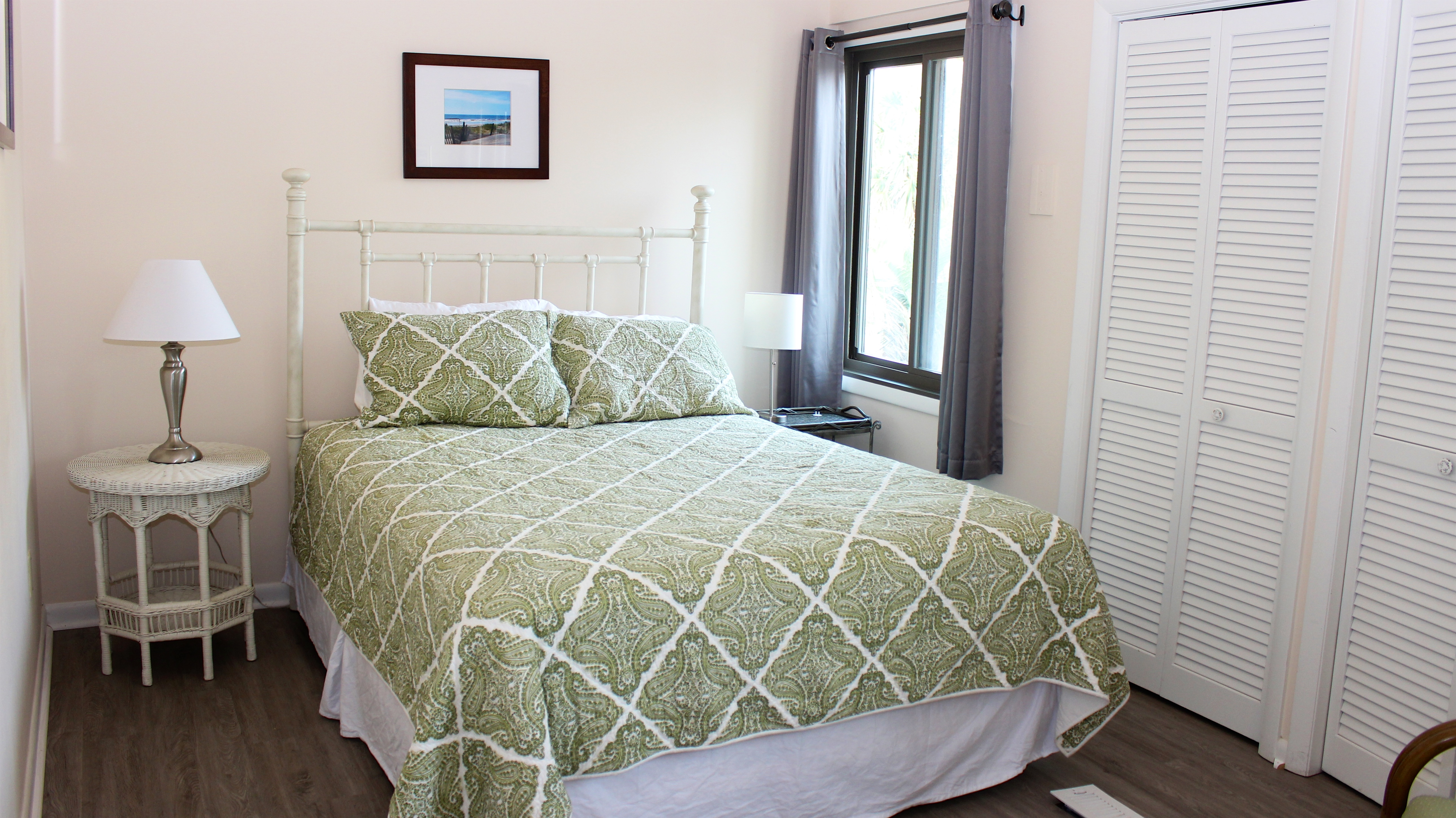 The 2nd bedroom is off the kitchen and has a queen bed.