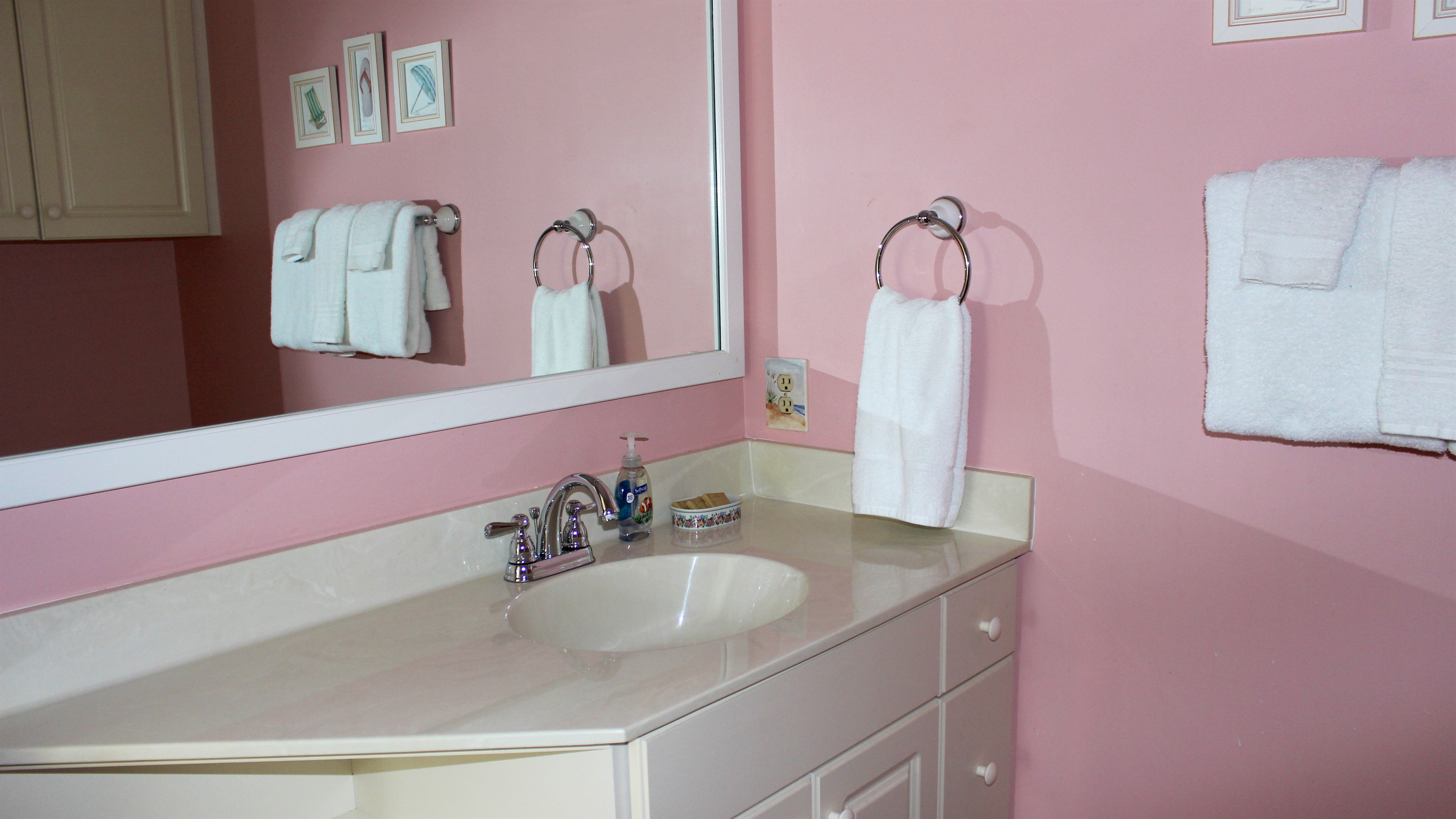 The adjoining bath has a large vanity area.