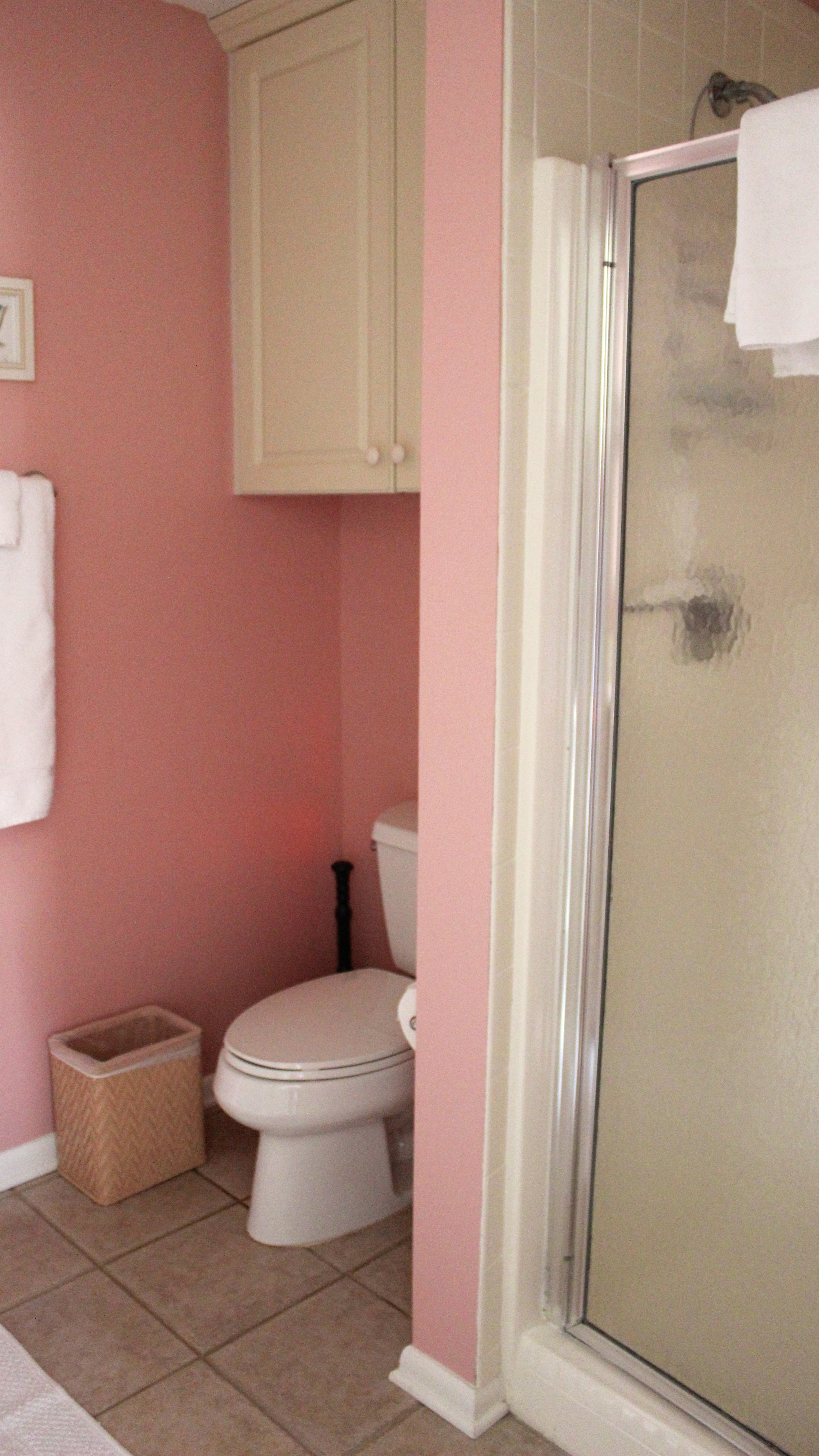 It also has a shower and tile flooring.
