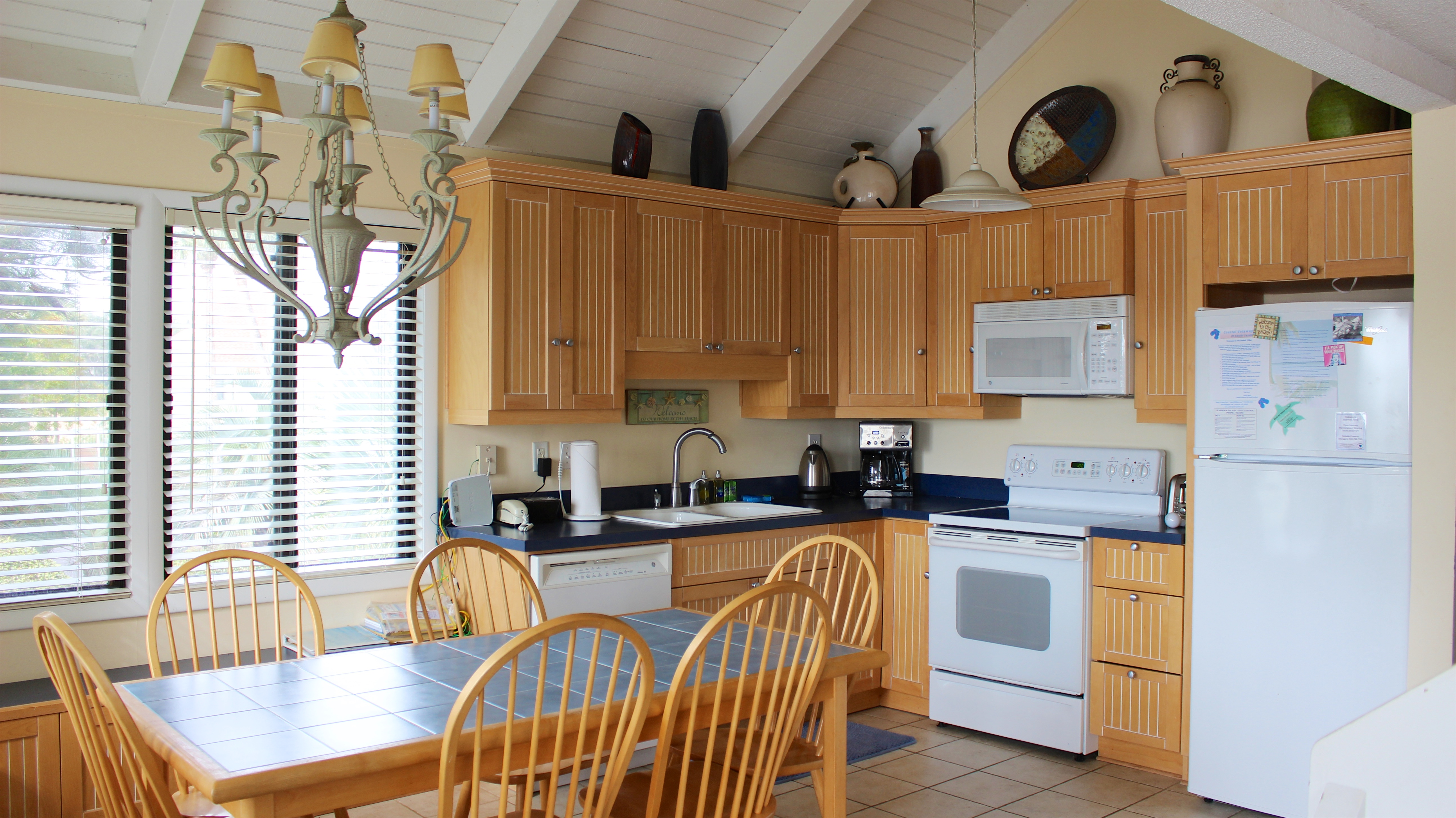 The kitchen has wainscot cabinets, new appliances, and is very open.