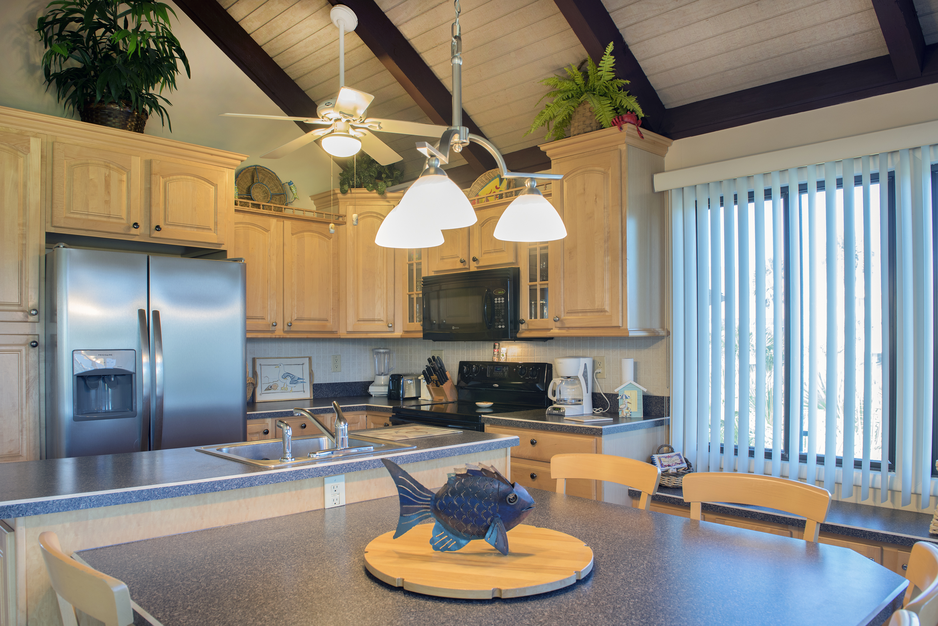 The kitchen is full of natural light and perfect for family meals.  There is a new refrigerator. The dining table seats six