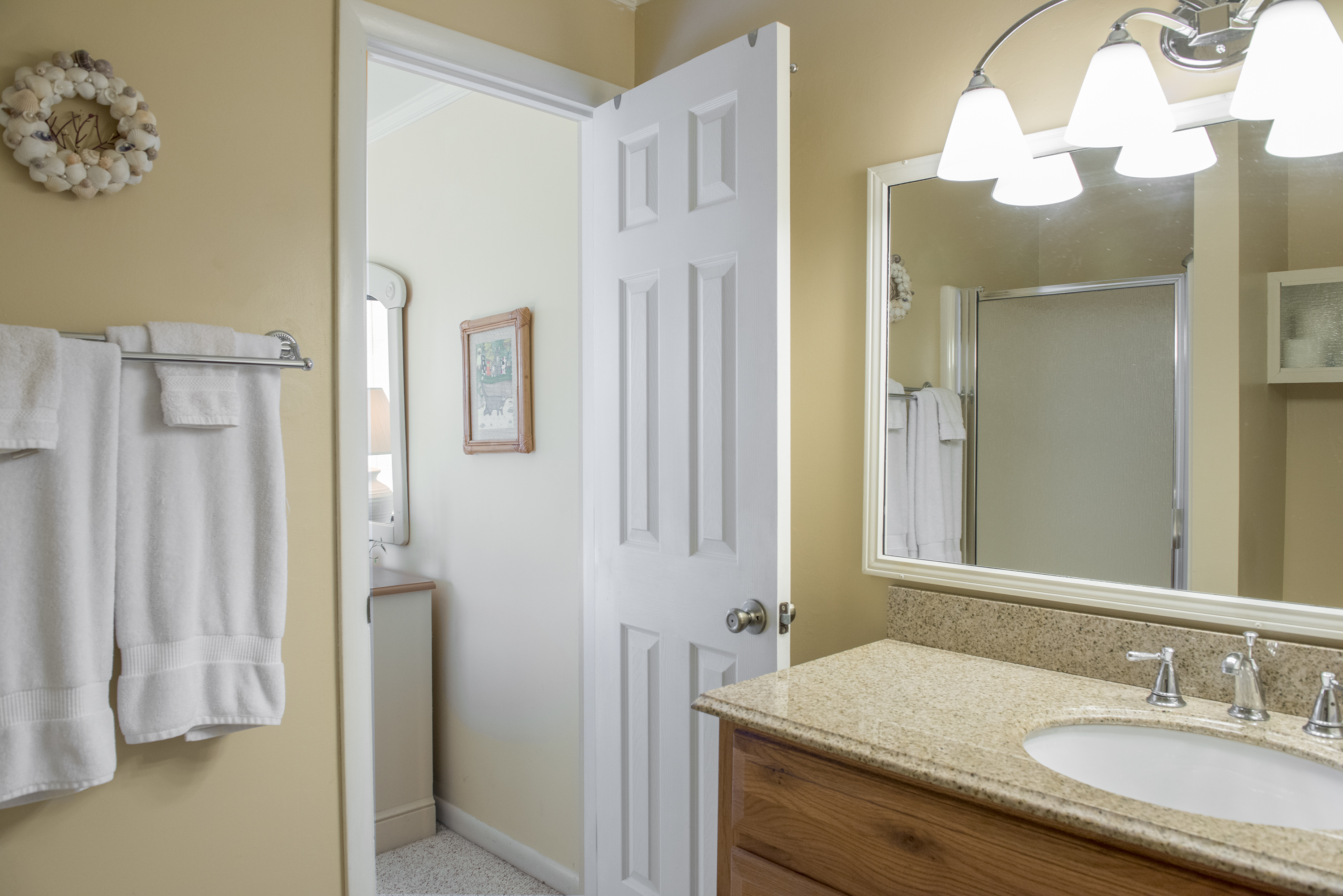 The master bathroom has an updated vanity and granite counters.