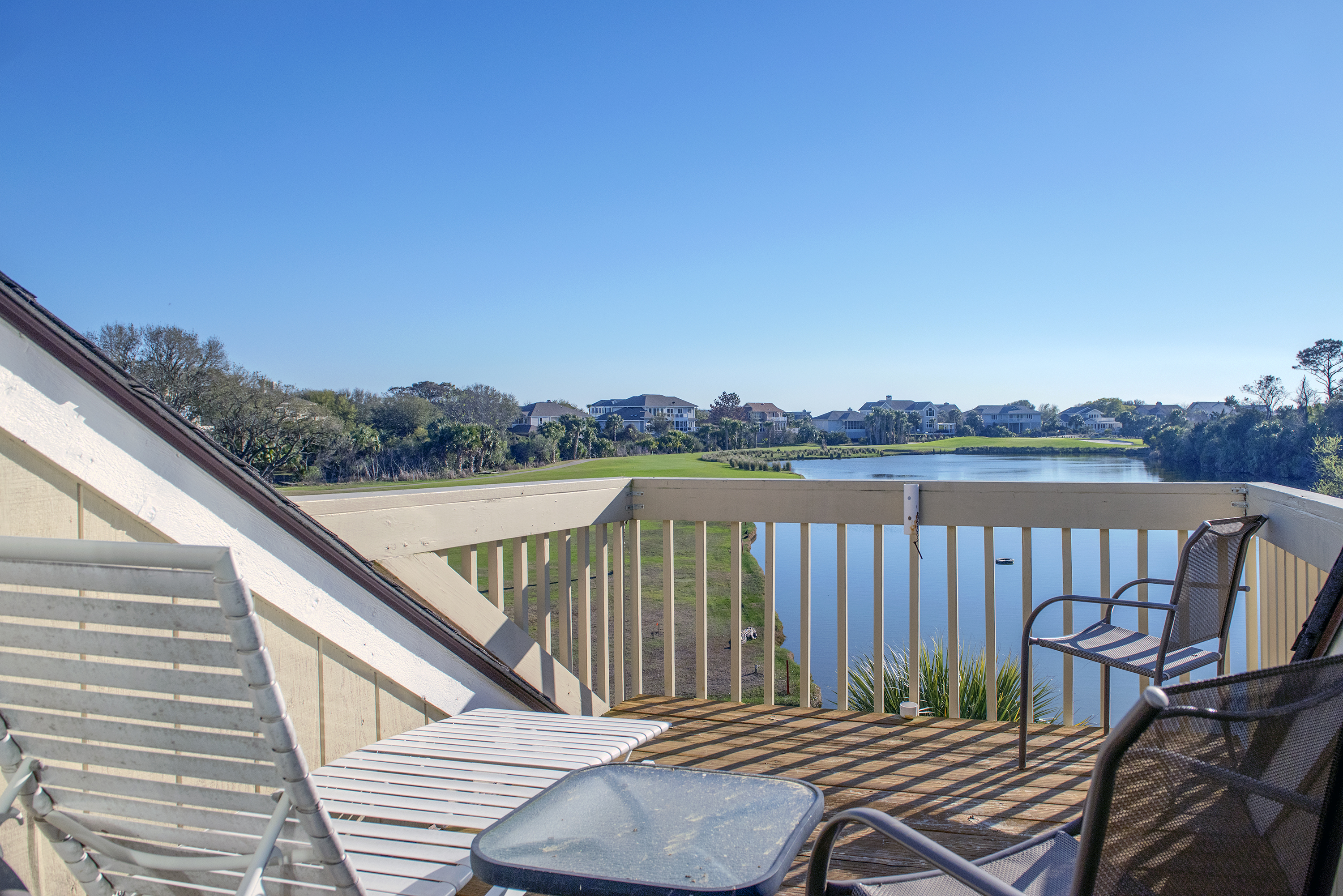 The sun deck has chairs and a chaise to relax in while enjoying the view.