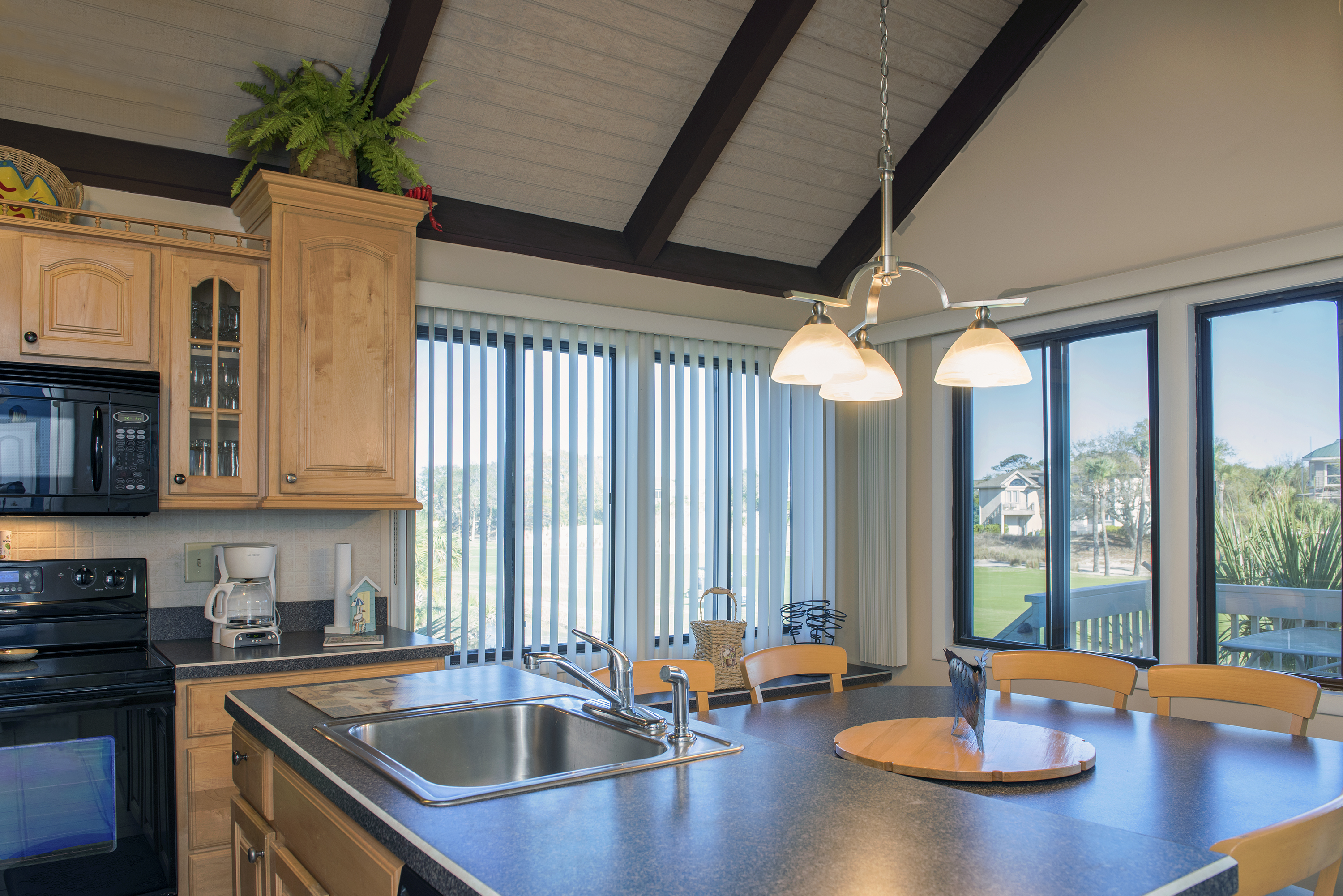 Windows with views to the golf course and lagoon surround you.