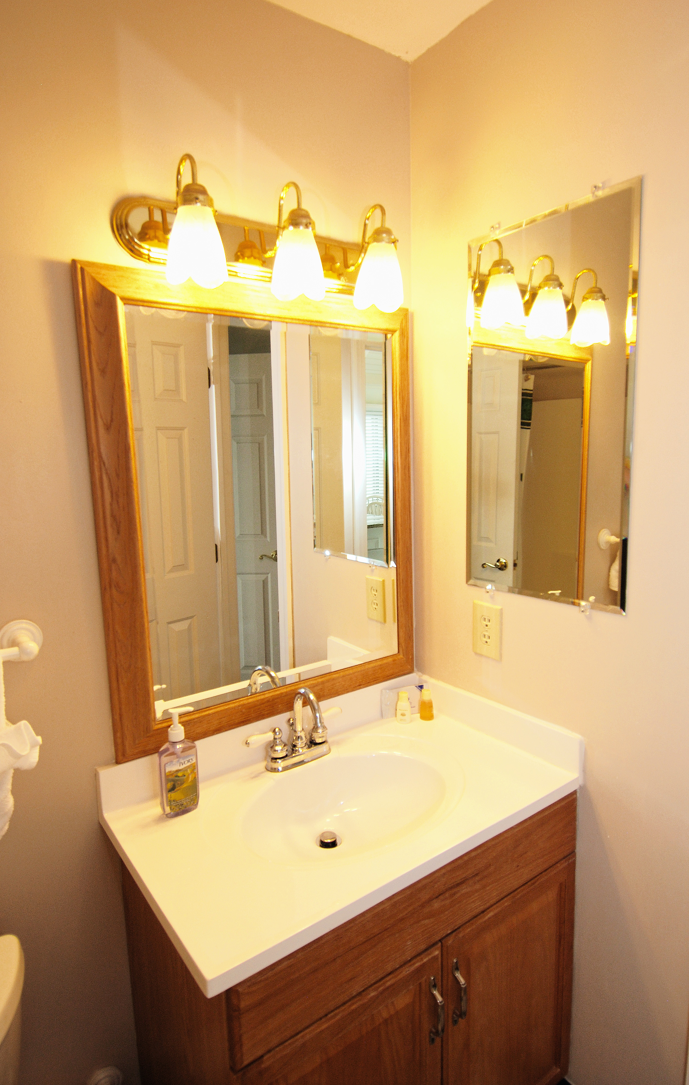 The full bath can be entered off the kitchen or from the first floor guest bedroom.