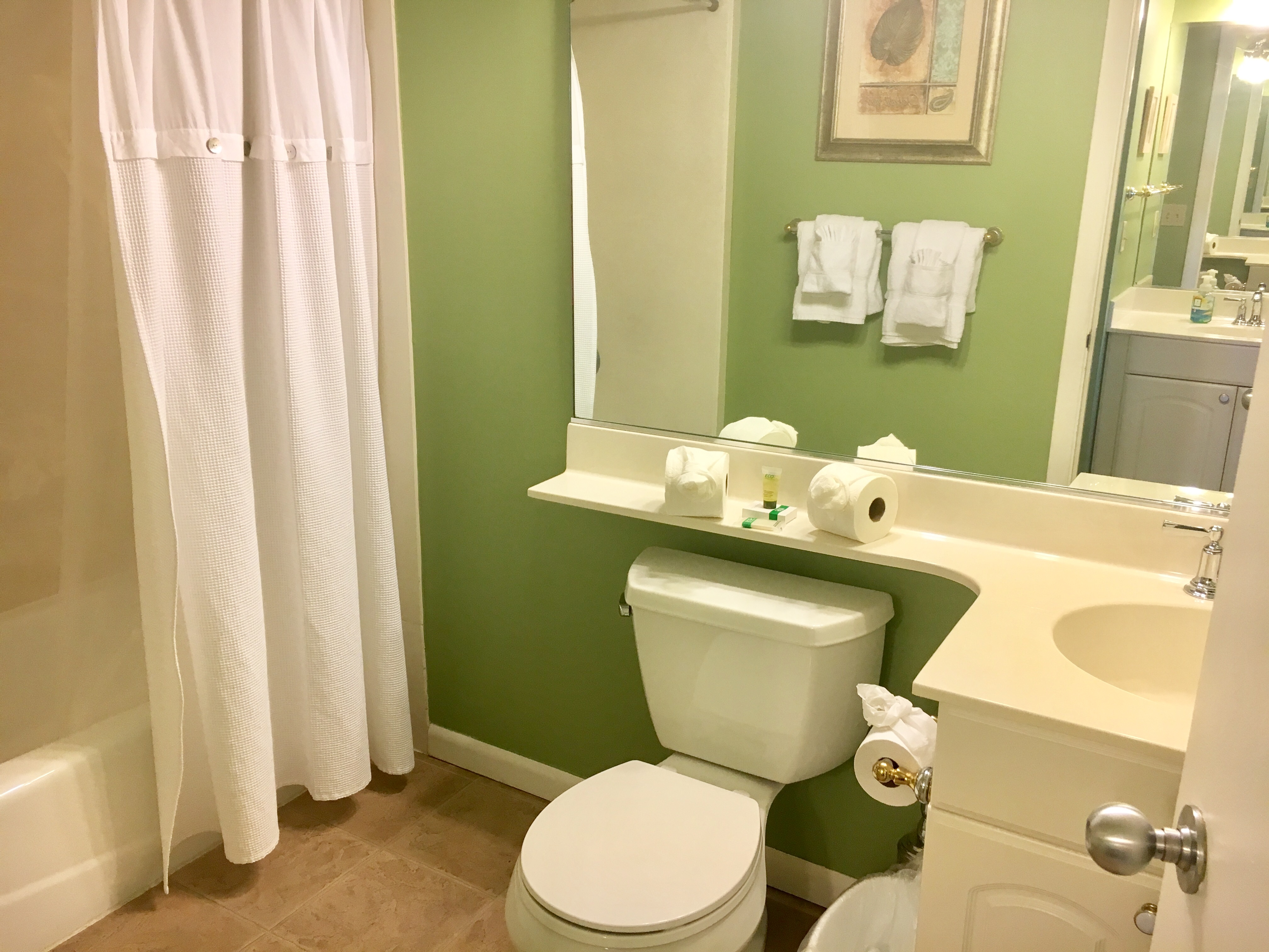 2nd bathroom has a shower/tub combination and separate sink.