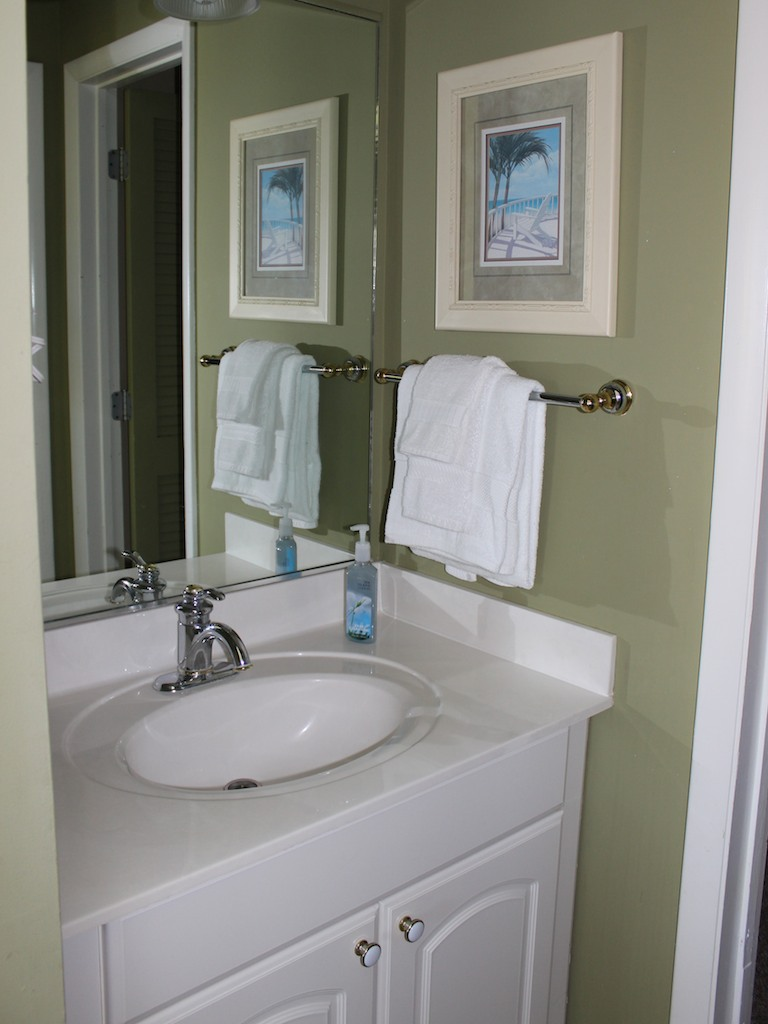 The bathroom has a separate sink area.