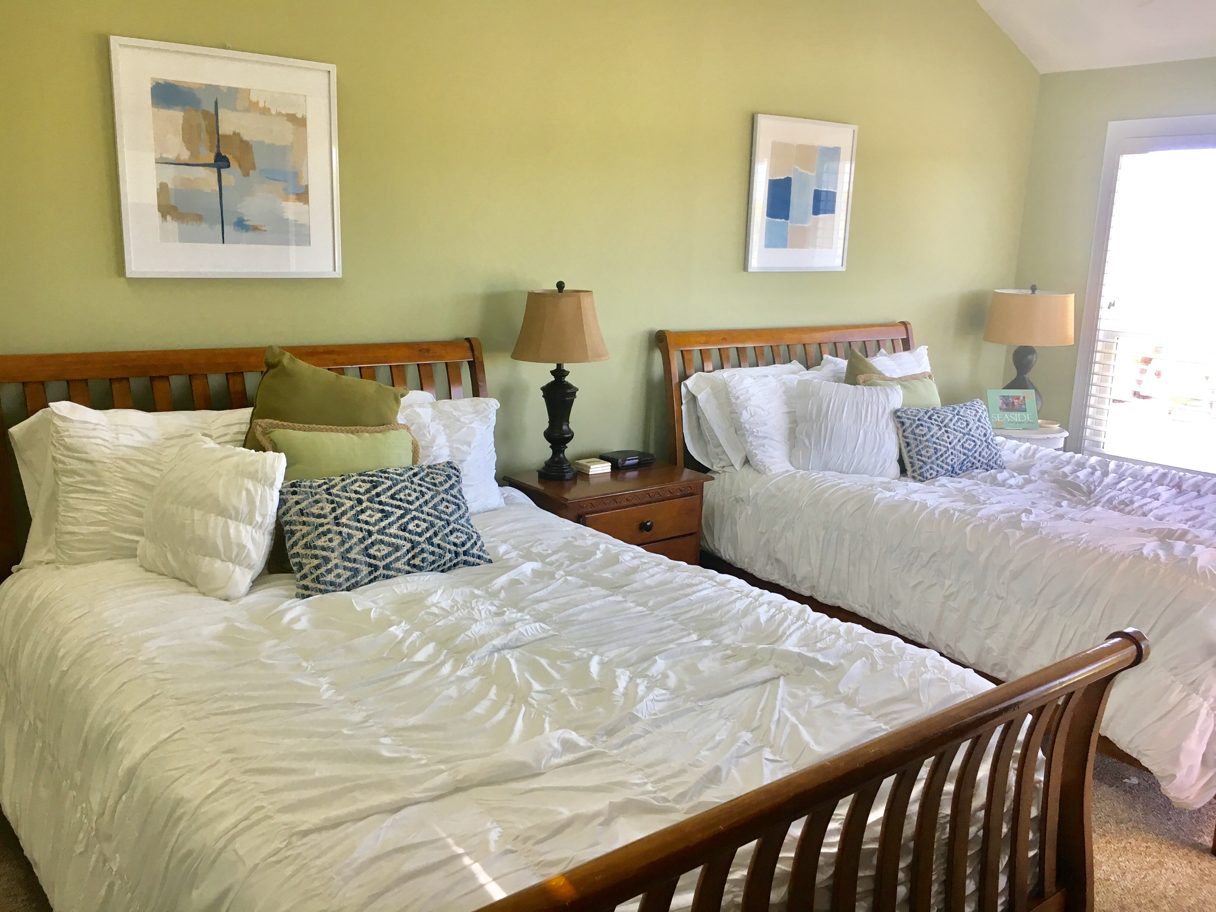 The master bedroom has two queen beds and a large HDTV.
