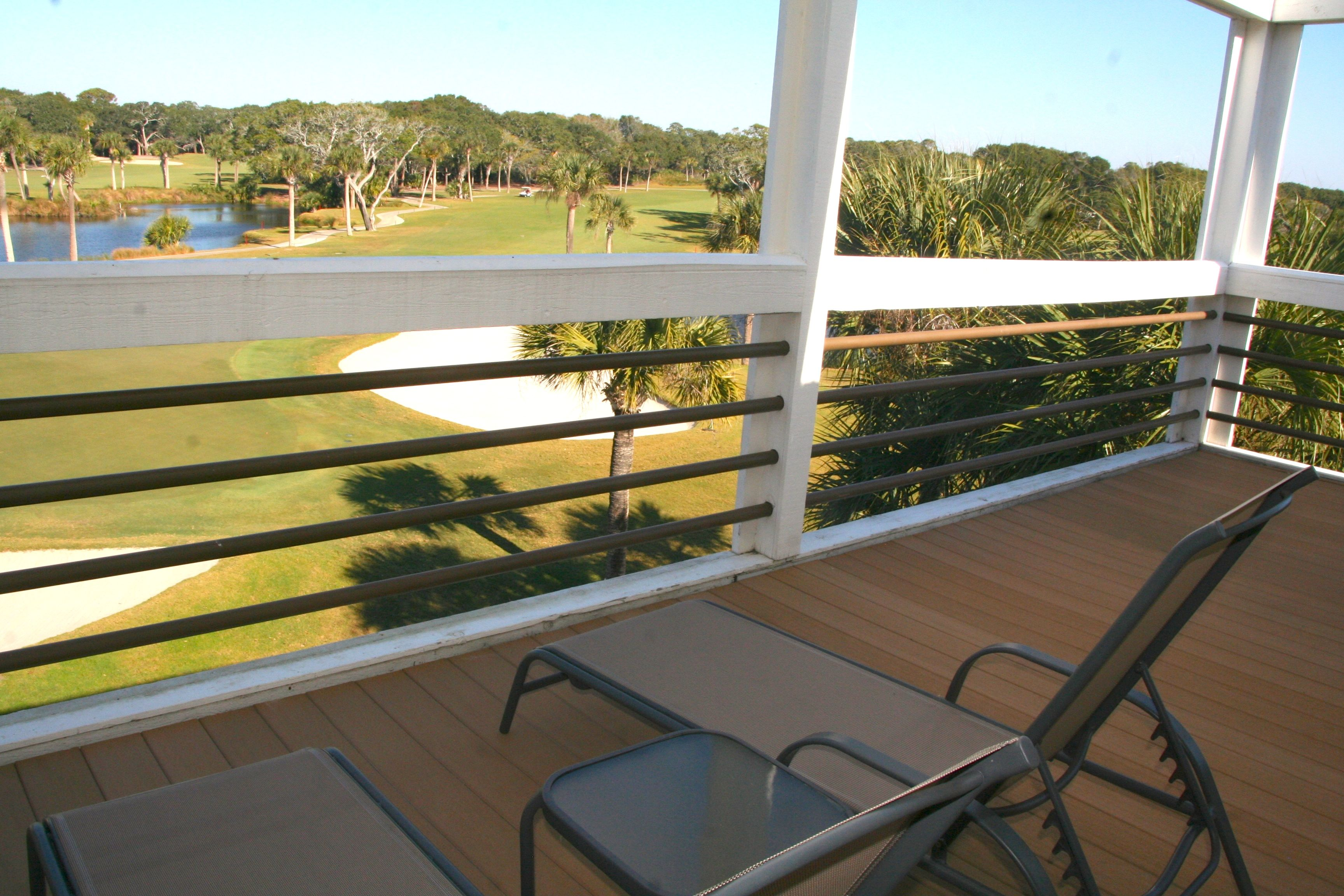 The porch is open and great for catching the sun or watching golfers & wildlife.