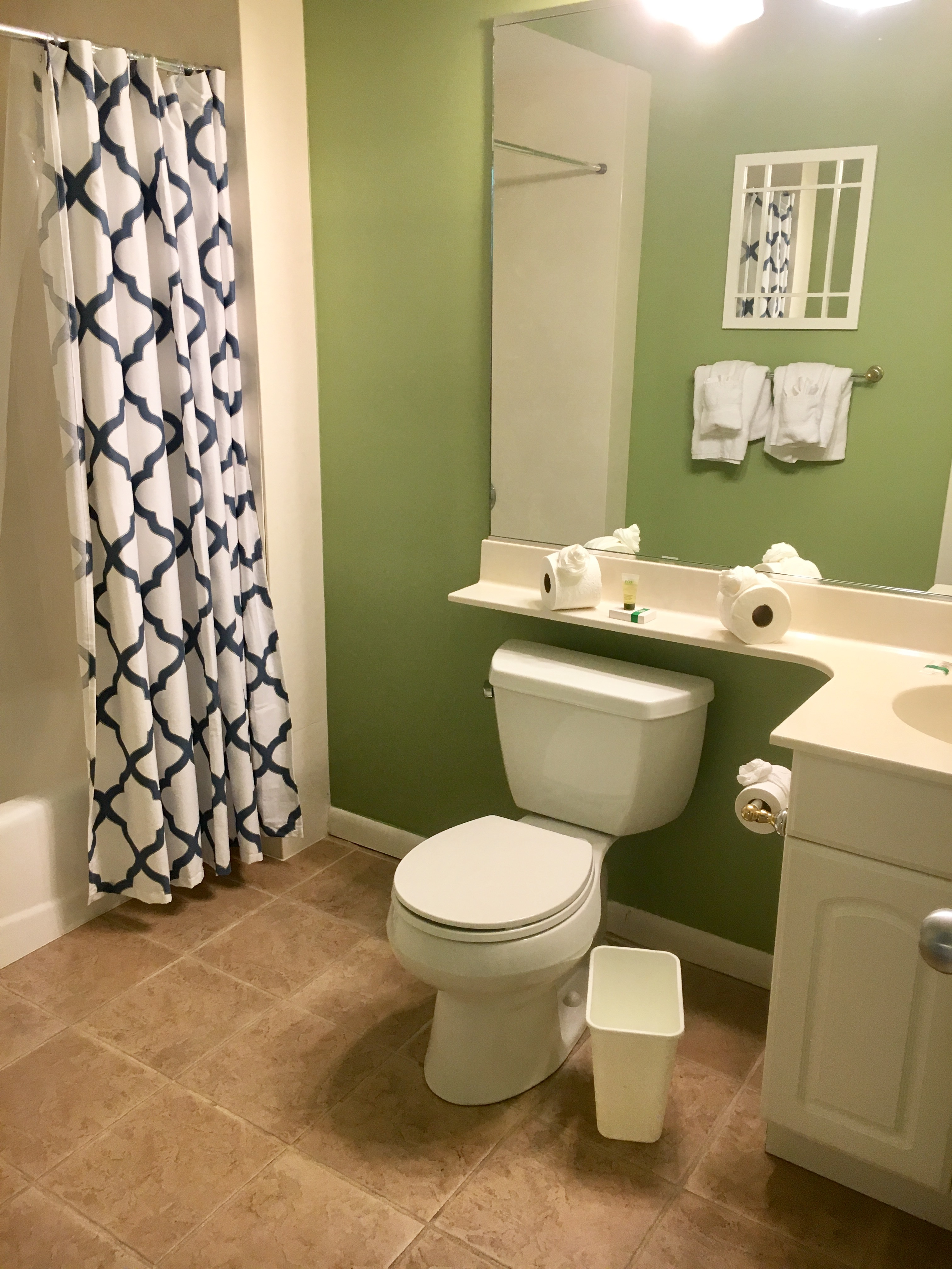 Spacious bathroom off the master bedroom with shower/tub combination.