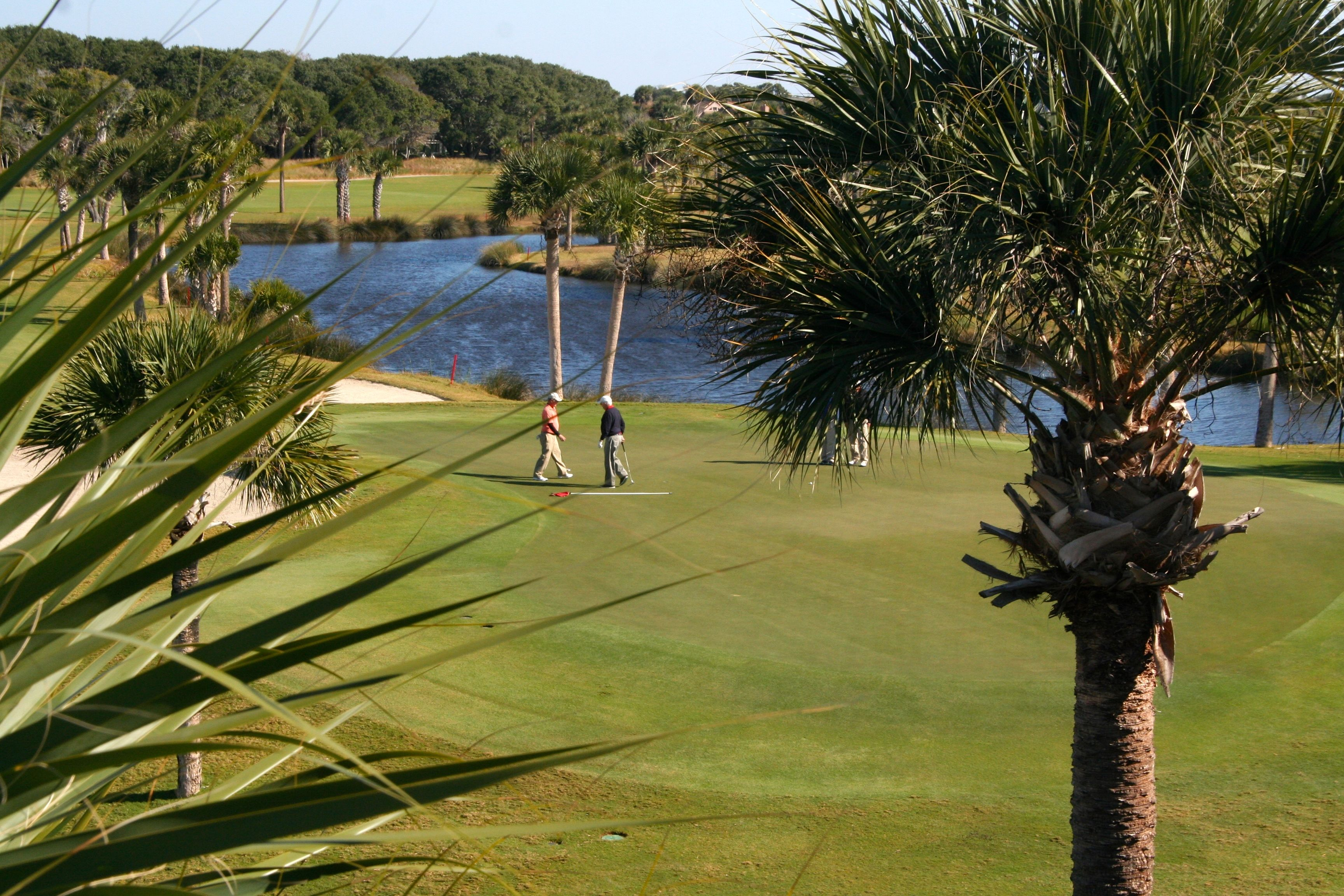 Watch the golfers navigate the 18th hole.