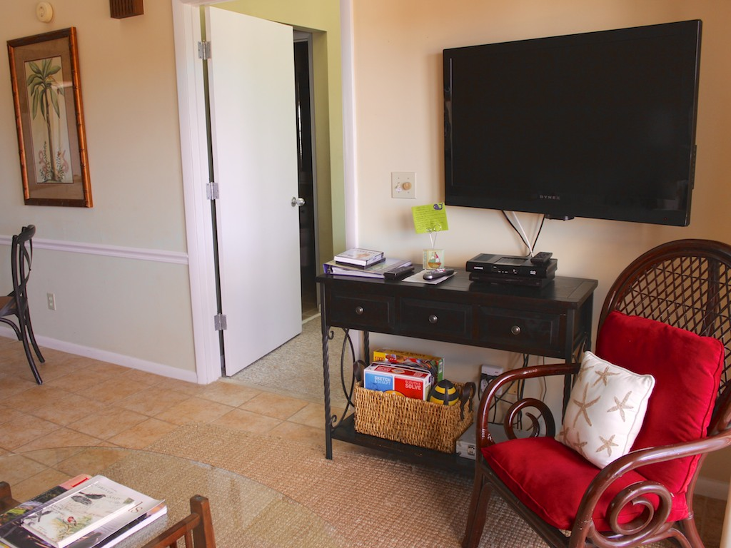 Watch shows and movies on the large wall mounted HDTV.