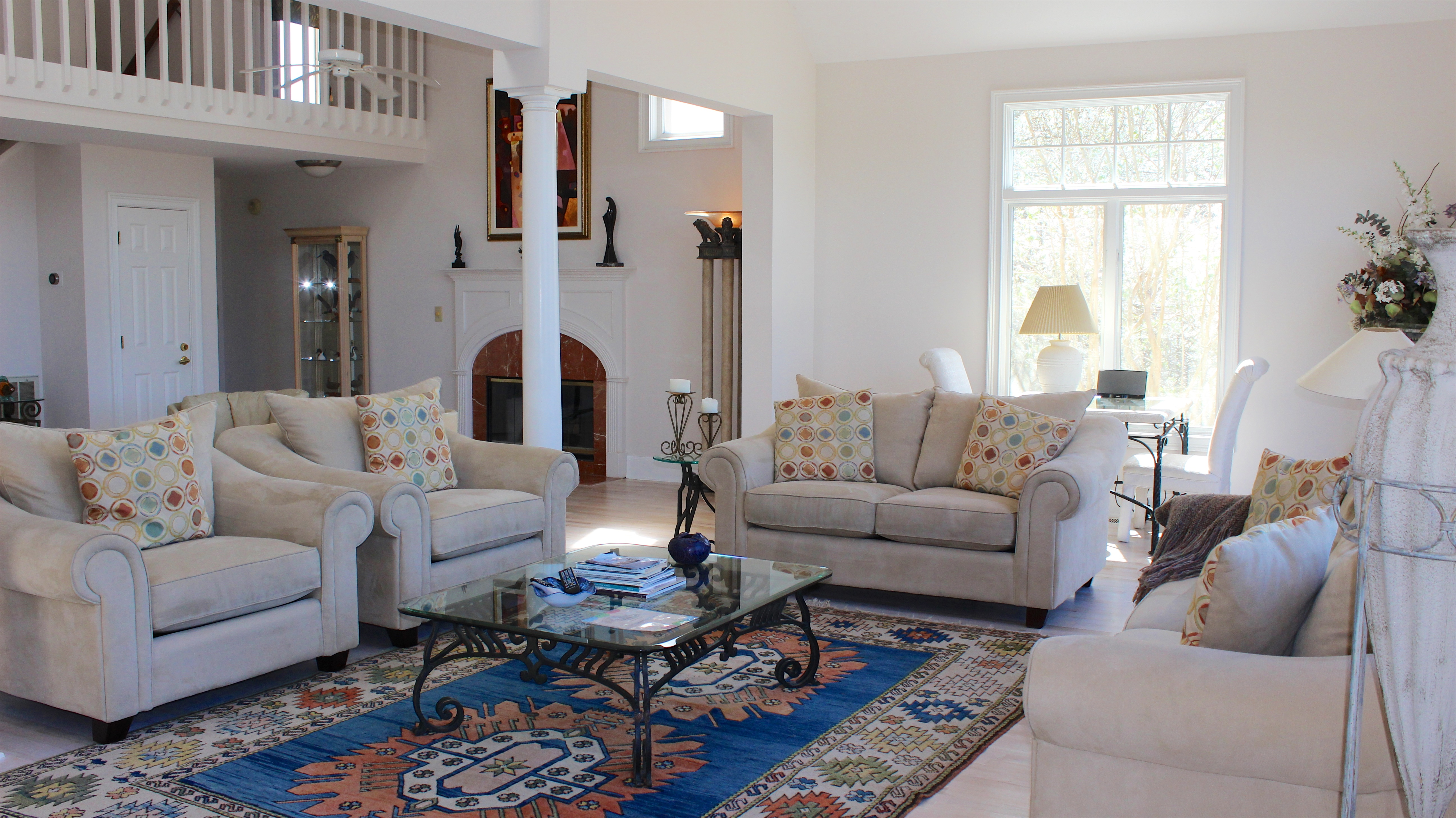 Cathedral ceilings and a balcony overlook the large living space.
