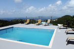 Large pool deck with lounge chairs and amazing views of St. Thomas