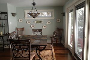 Dining area, sliding glass door to porch.