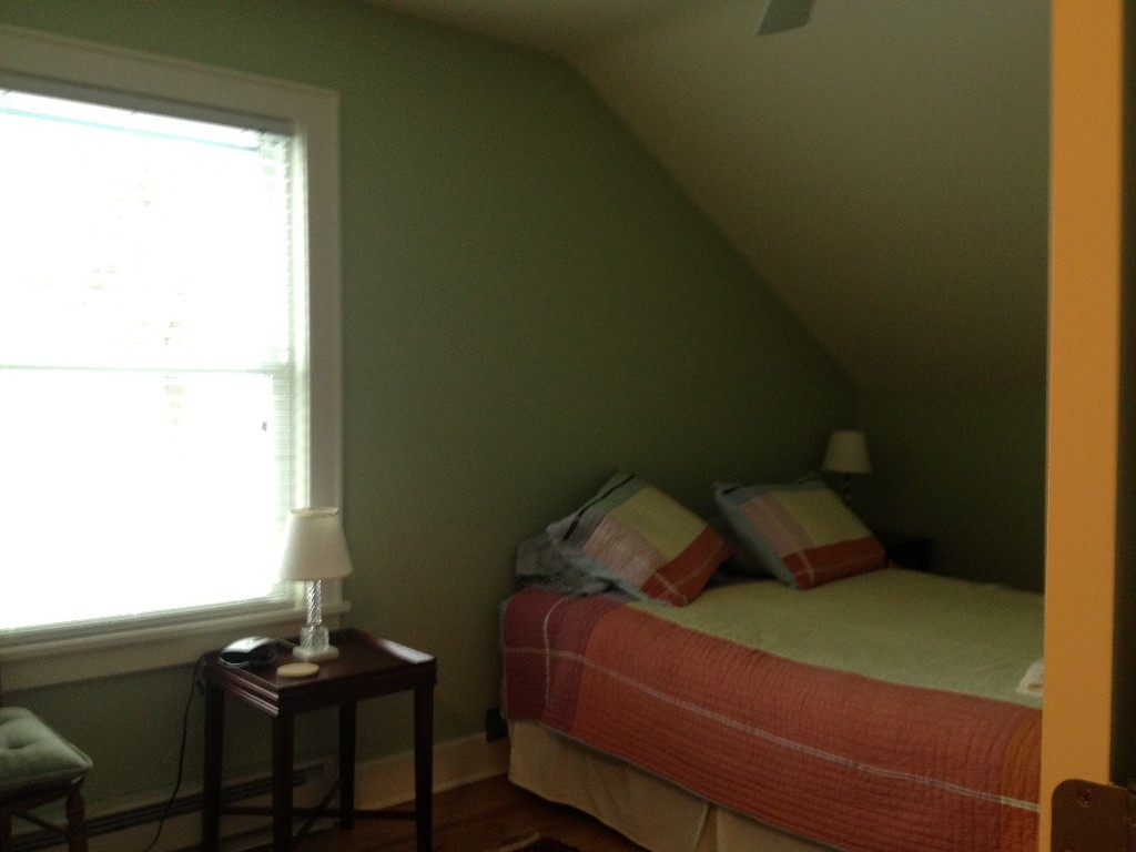 Green room upstairs with queen size bed.