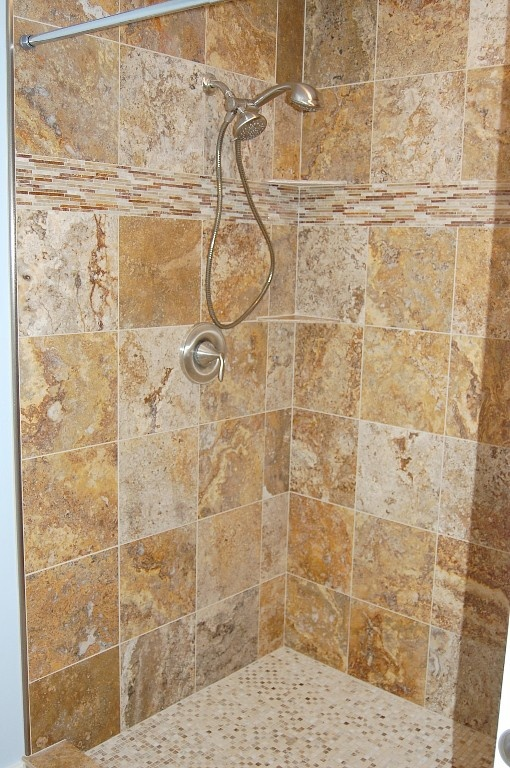 Master bath shower, natural stone tile.