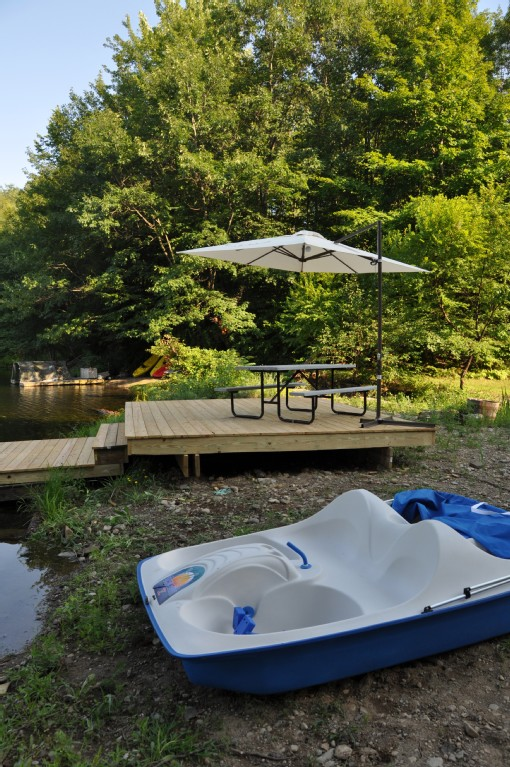 Dock 1 with table/ umbrella and paddle boat