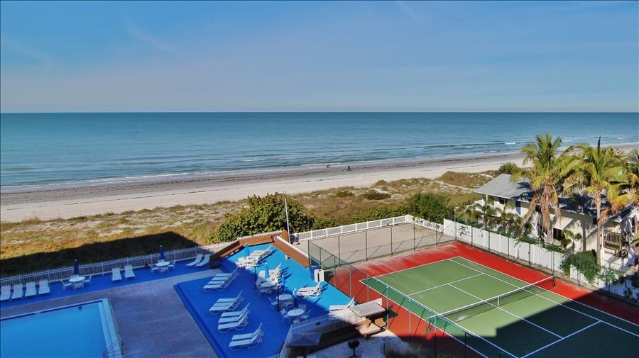 Balcony View of Tennis Courts, Pool & Beach
