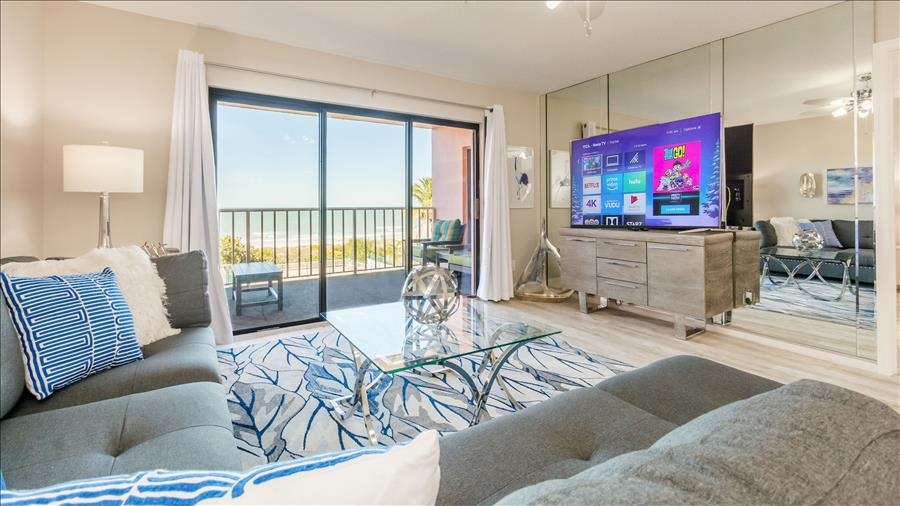 Living Room with TV & Balcony