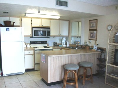 Kitchen with full size Dishwasher, Stove and Refrigerator