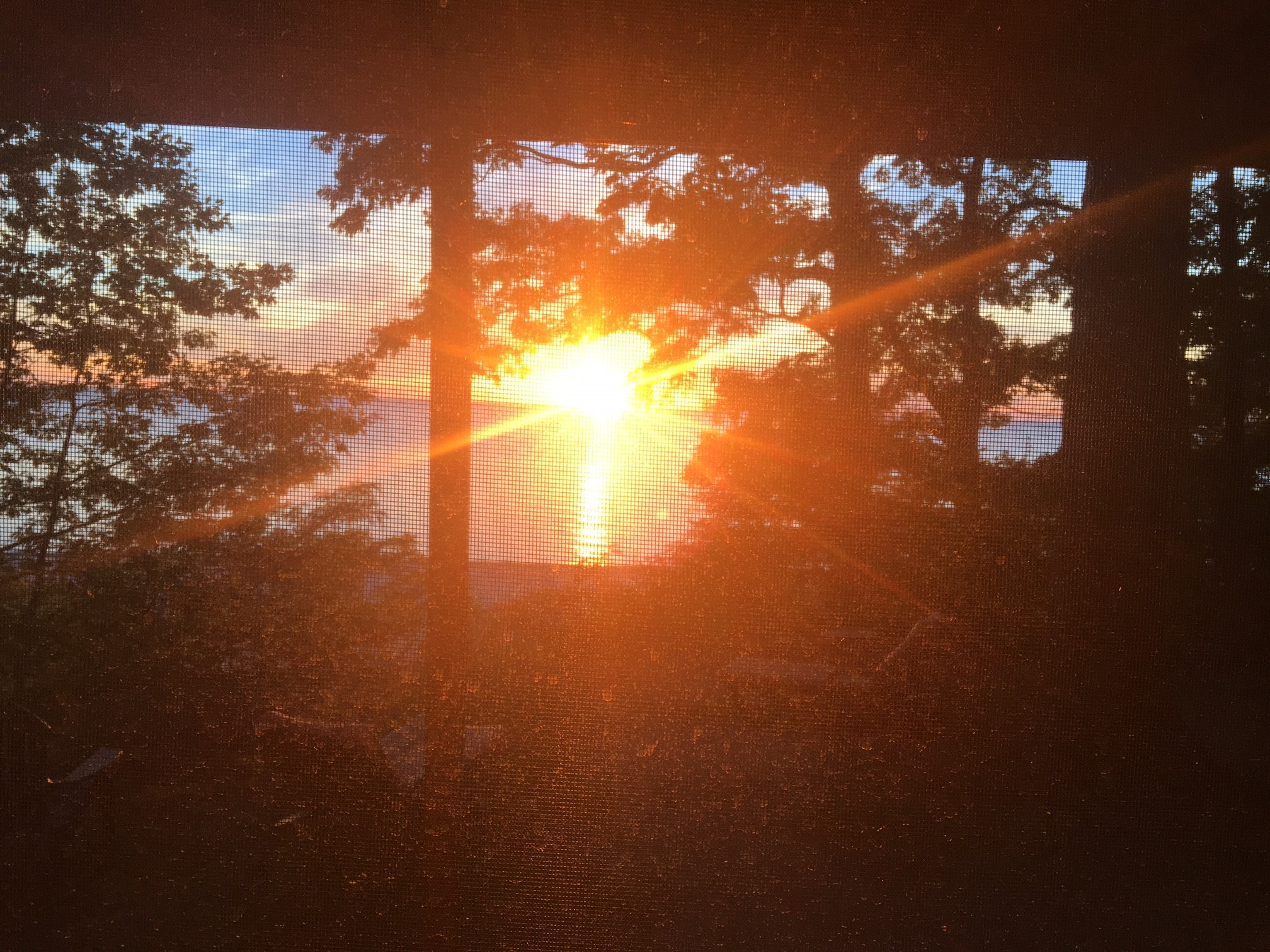 Sunset View from inside of the Angola Beach House