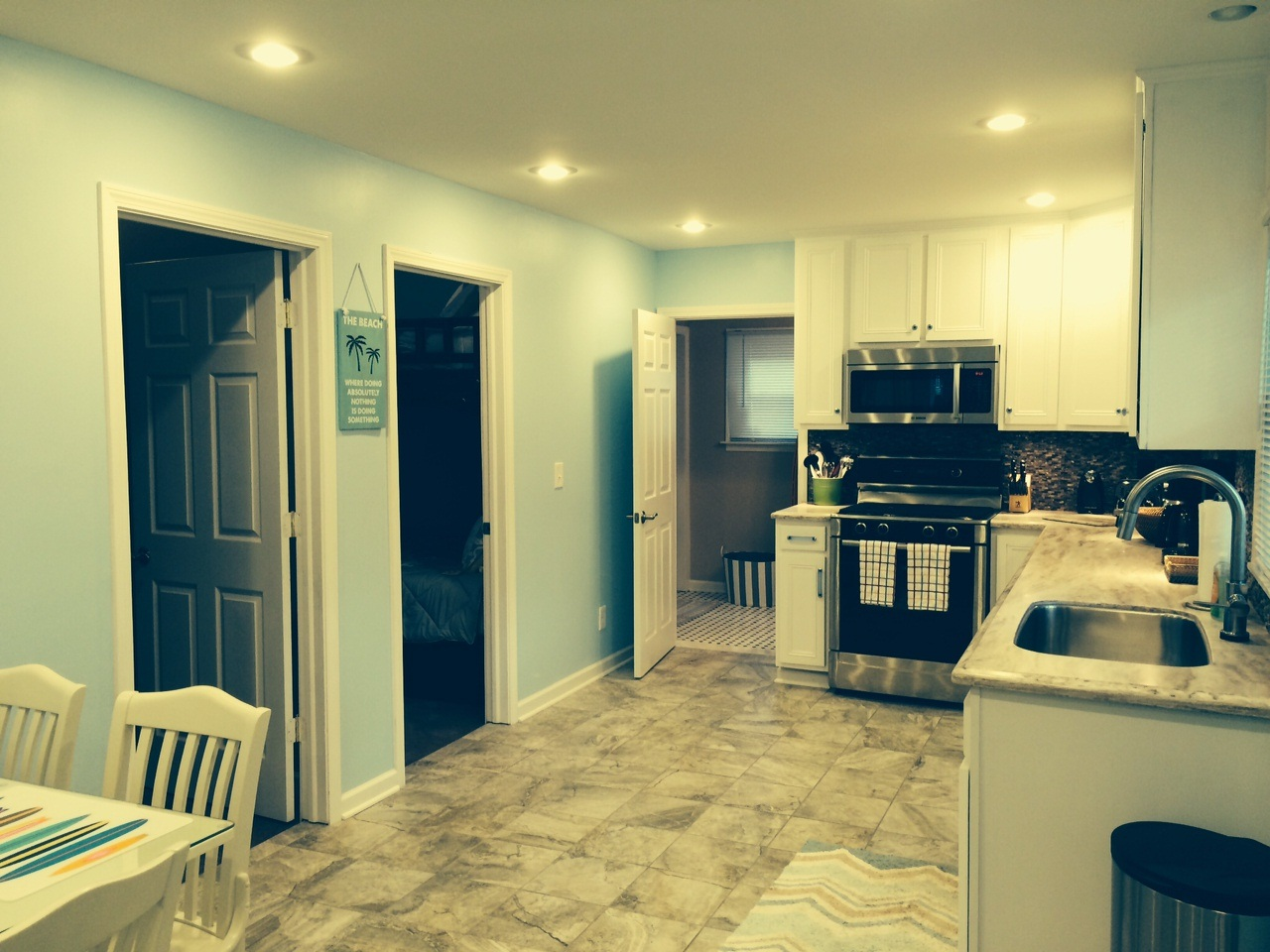 Kitchen Area and Doors to the Bedrooms and Bathroom