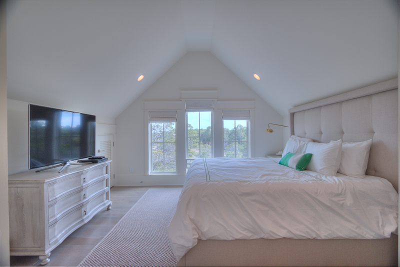 Third floor king bedroom with flat screen tv, forest views