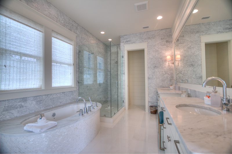Large and similarly appointed bathroom to the main master, double sinks, make up seating area