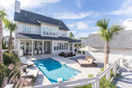 Large private pool and veranda area with loungers, seating area and outdoor dining