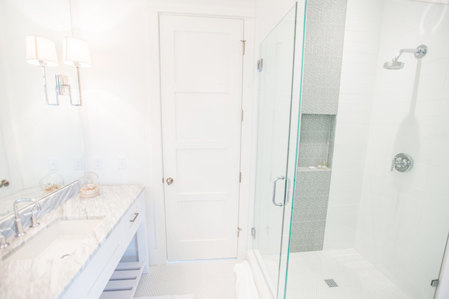 Luxurious bright bathrooms with upscale finishes and materials
